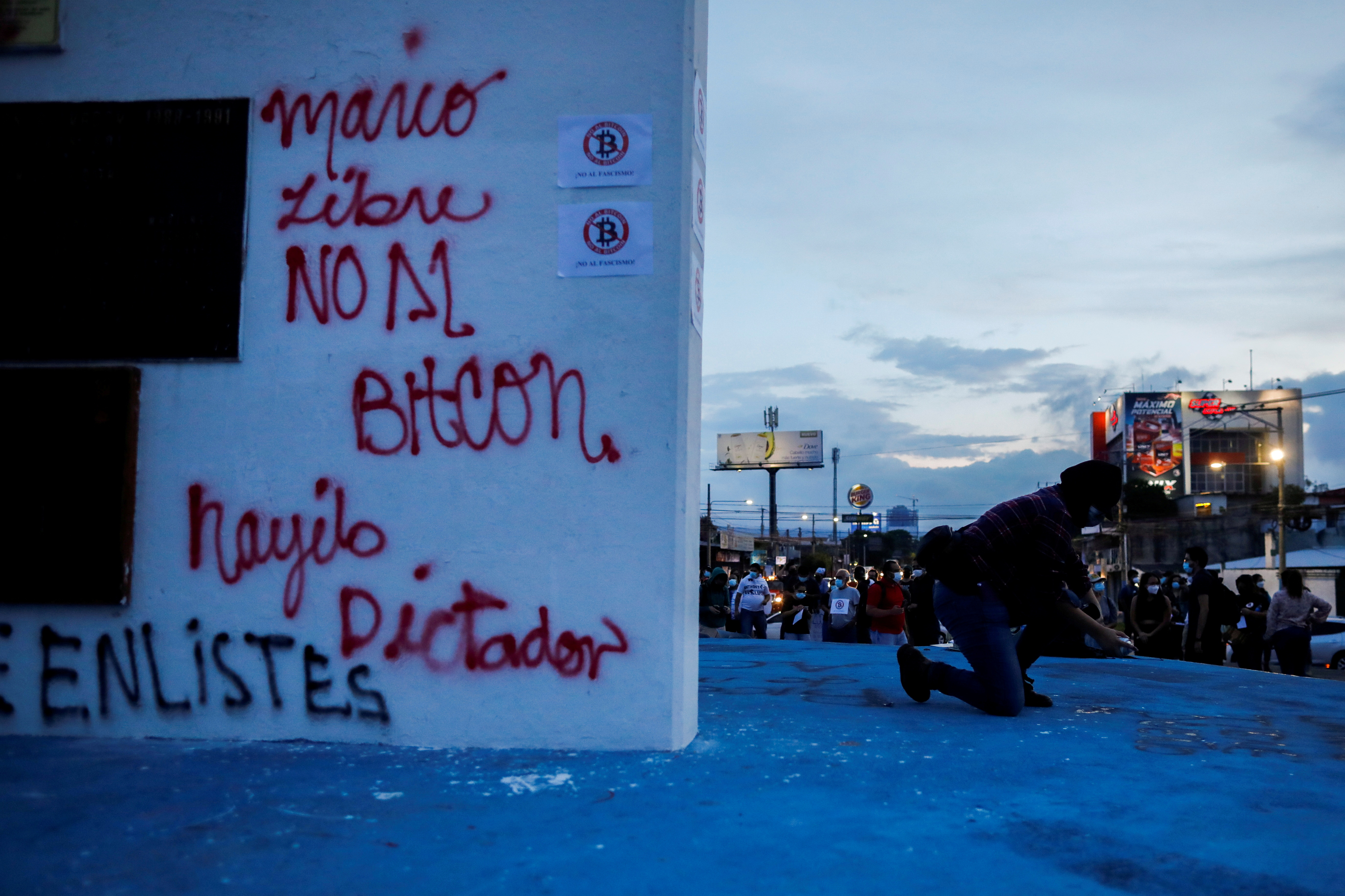 A man takes part in a protest against the detention of cryptocurrency commentator Mario Gomez, and against the use of bitcoin as legal tender, in San Salvador, El Salvador, September 1, 2021. REUTERS/Jose Cabezas