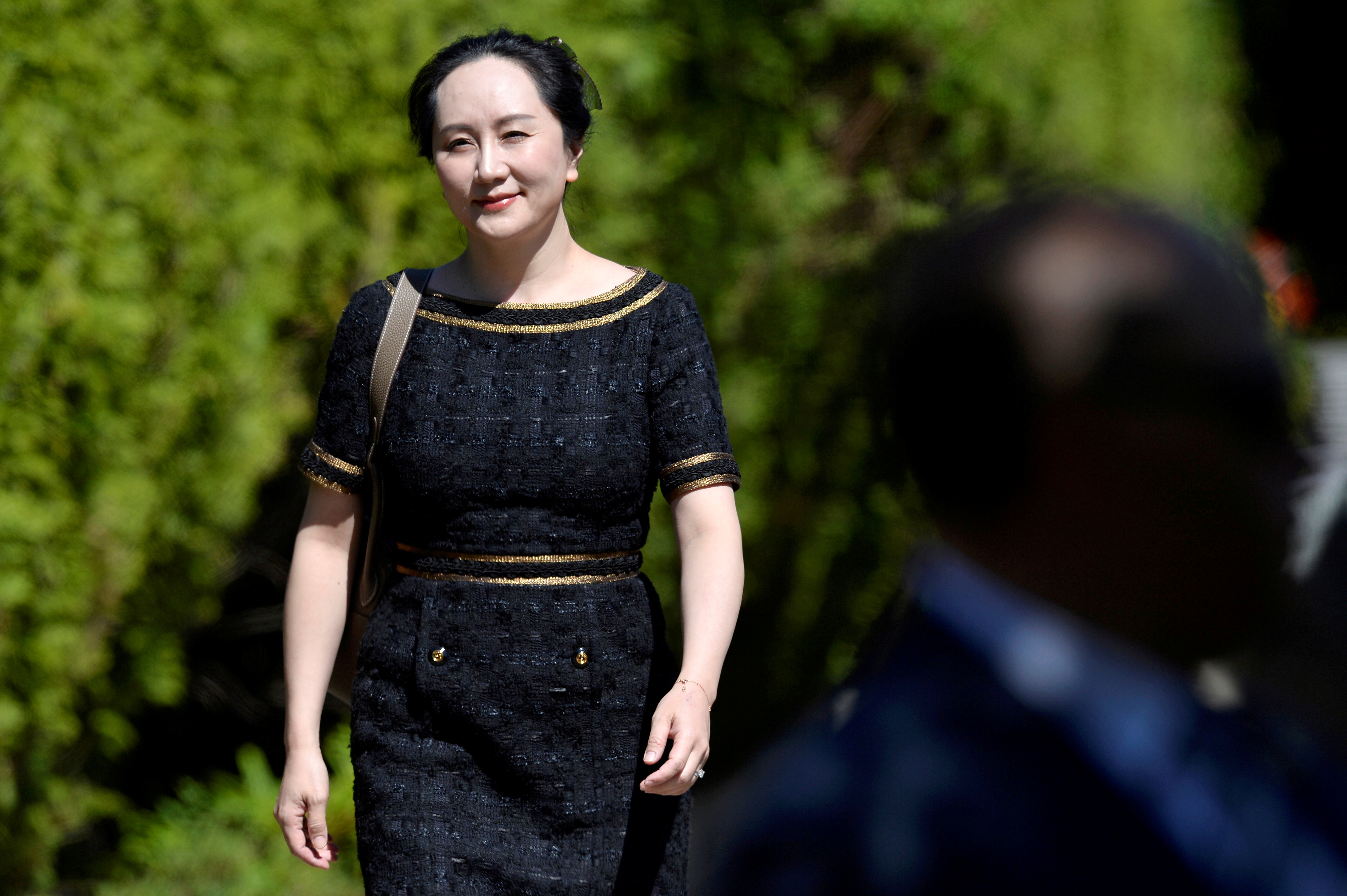 Huawei Technologies Chief Financial Officer Meng Wanzhou leaves her home to attend a court hearing in Vancouver, British Columbia, Canada May 27, 2020. REUTERS/Jennifer Gauthier