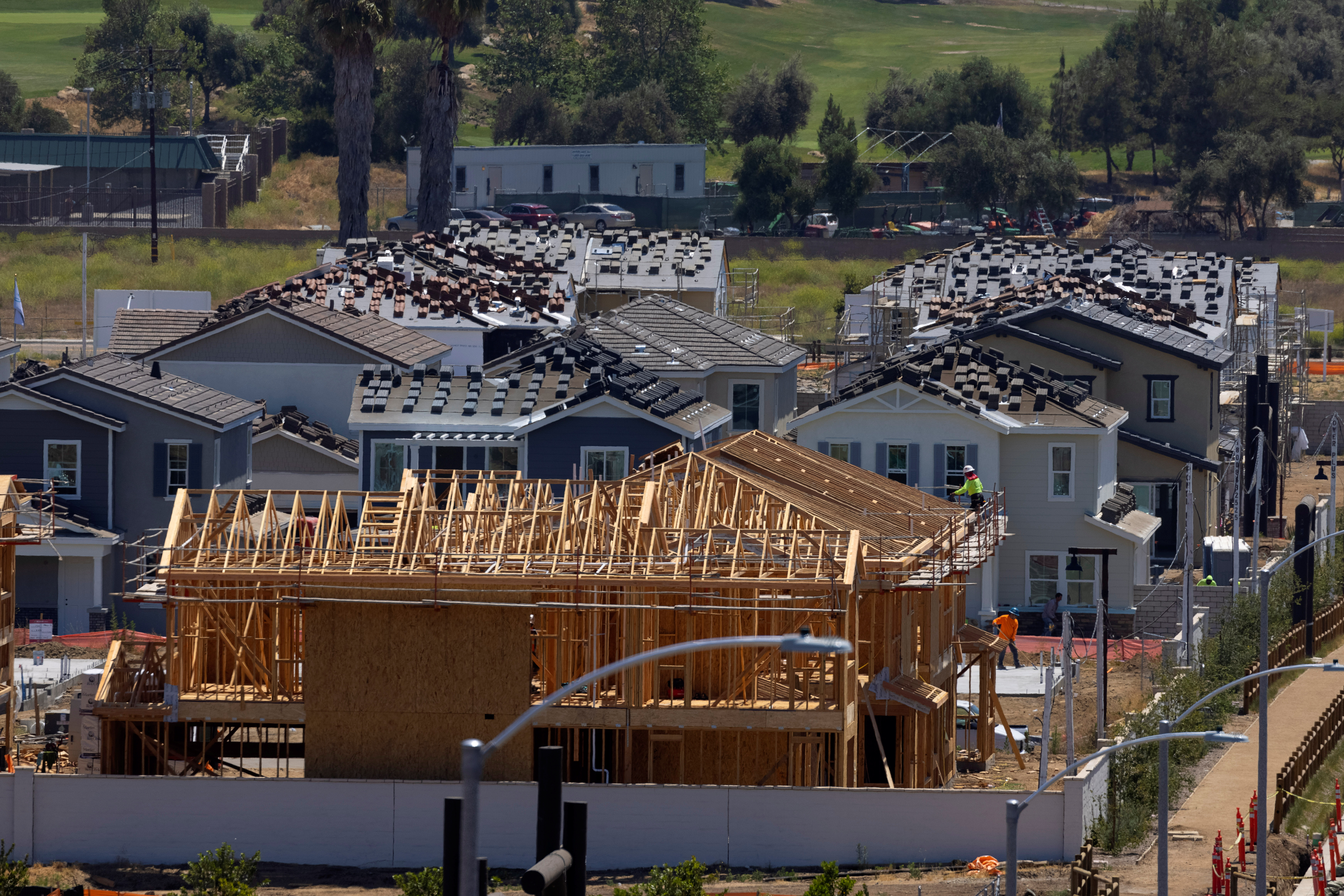 Residential single family homes construction by KB Home are shown under construction in the community of Valley Center, California, U.S. June 3, 2021.   REUTERS/Mike Blake
