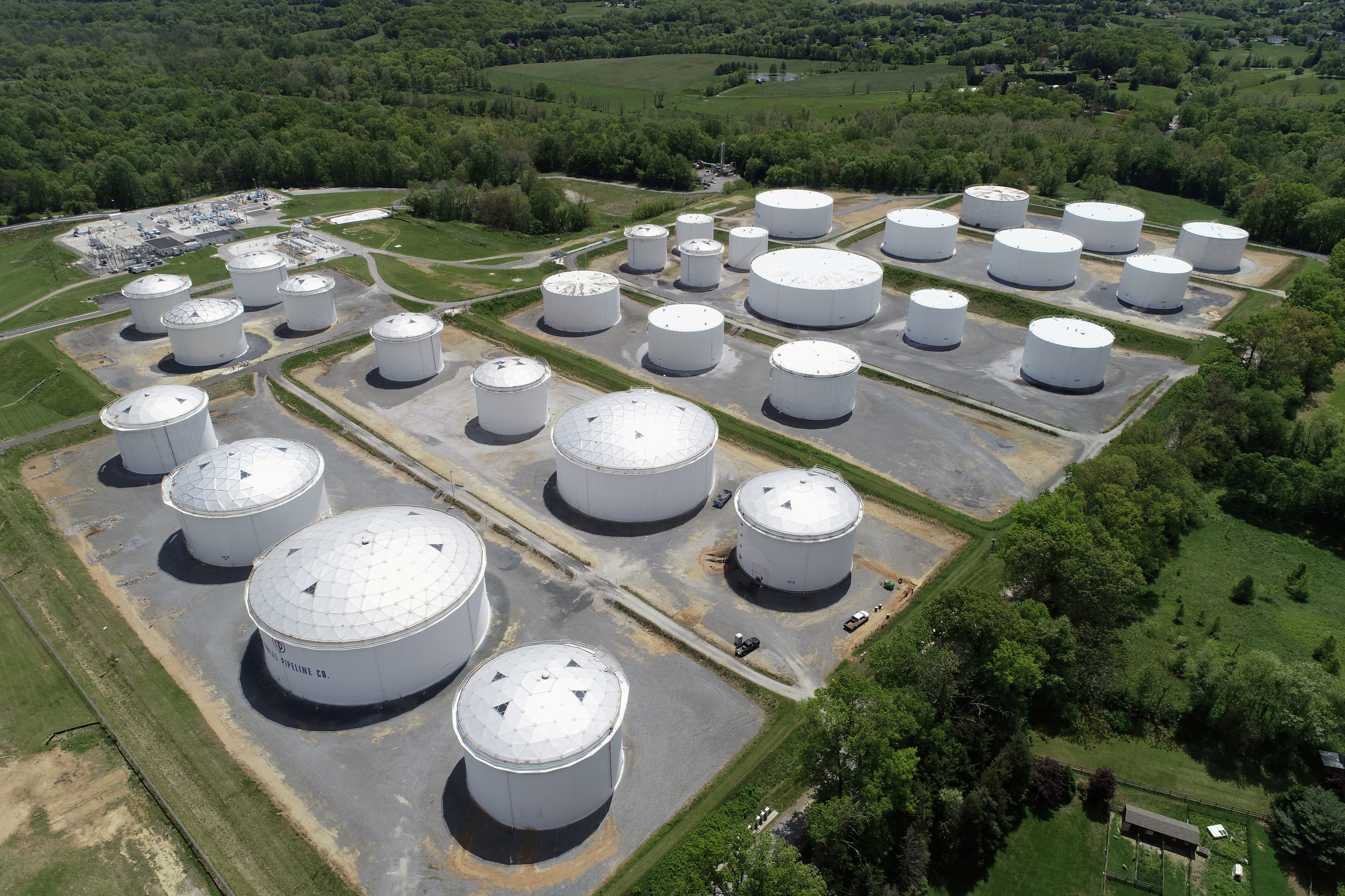 Holding tanks are seen in an aerial photograph at Colonial Pipeline's Dorsey Junction Station in Woodbine, Maryland, U.S. May 10, 2021. REUTERS/Drone Base/File Photo