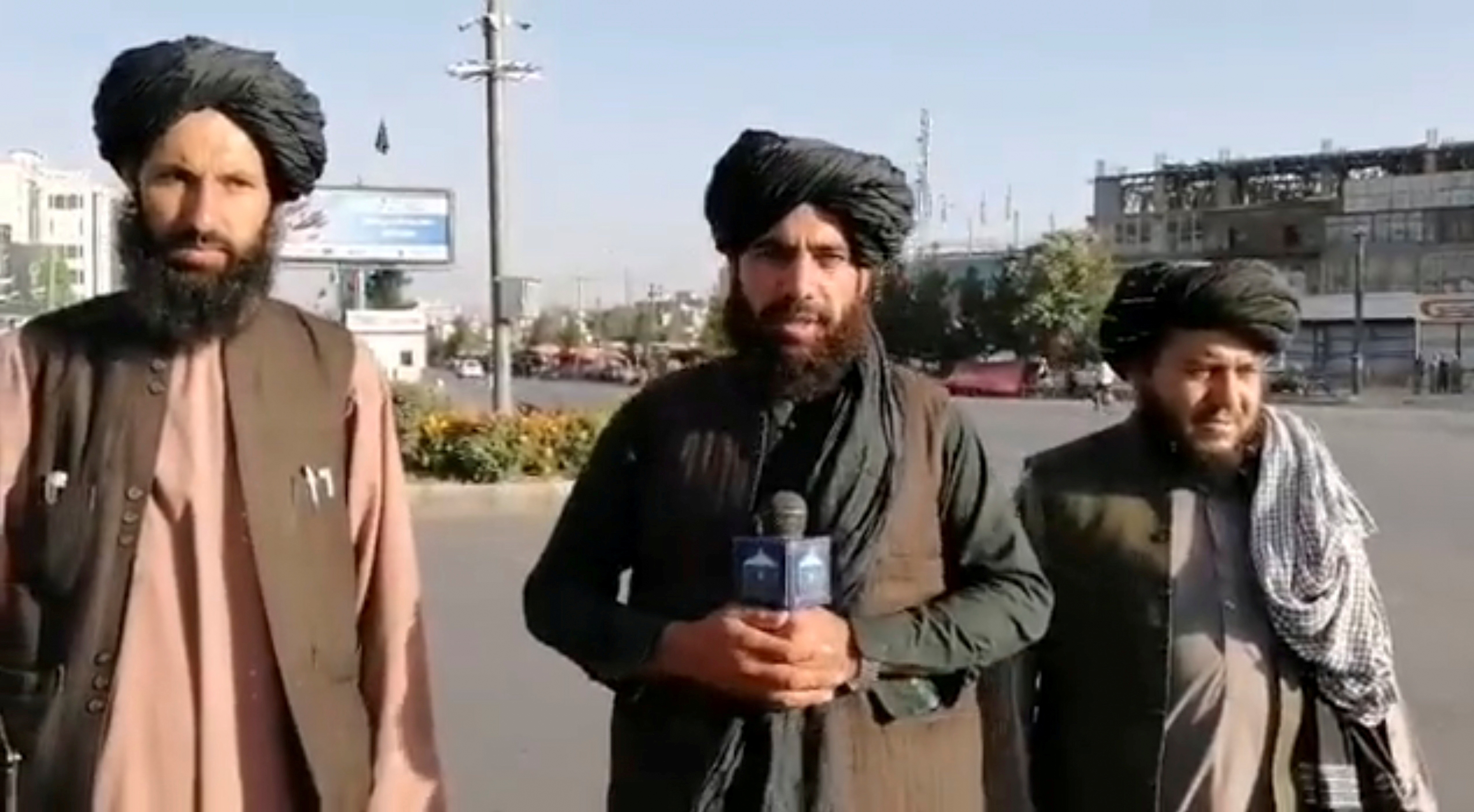 A man holds a wireless microphone as he speaks on the street in Kabul, Afghanistan, in this still image taken from social media video uploaded August 16, 2021 and obtained by REUTERS THIS IMAGE HAS BEEN SUPPLIED BY A THIRD PARTY./File Photo