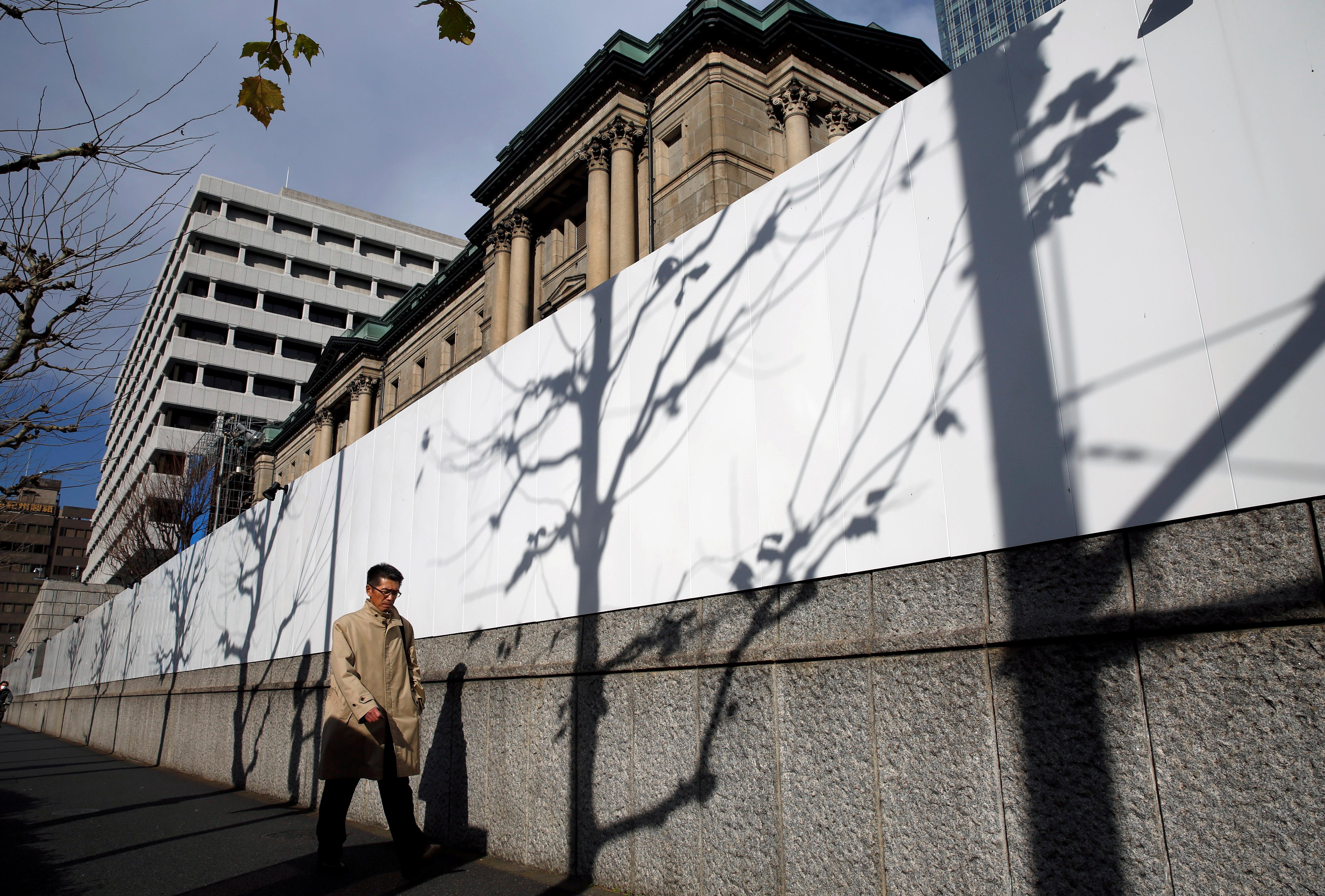 A man walks past the Bank of Japan building in Tokyo, Japan January 15, 2018. REUTERS/Kim Kyung-Hoon