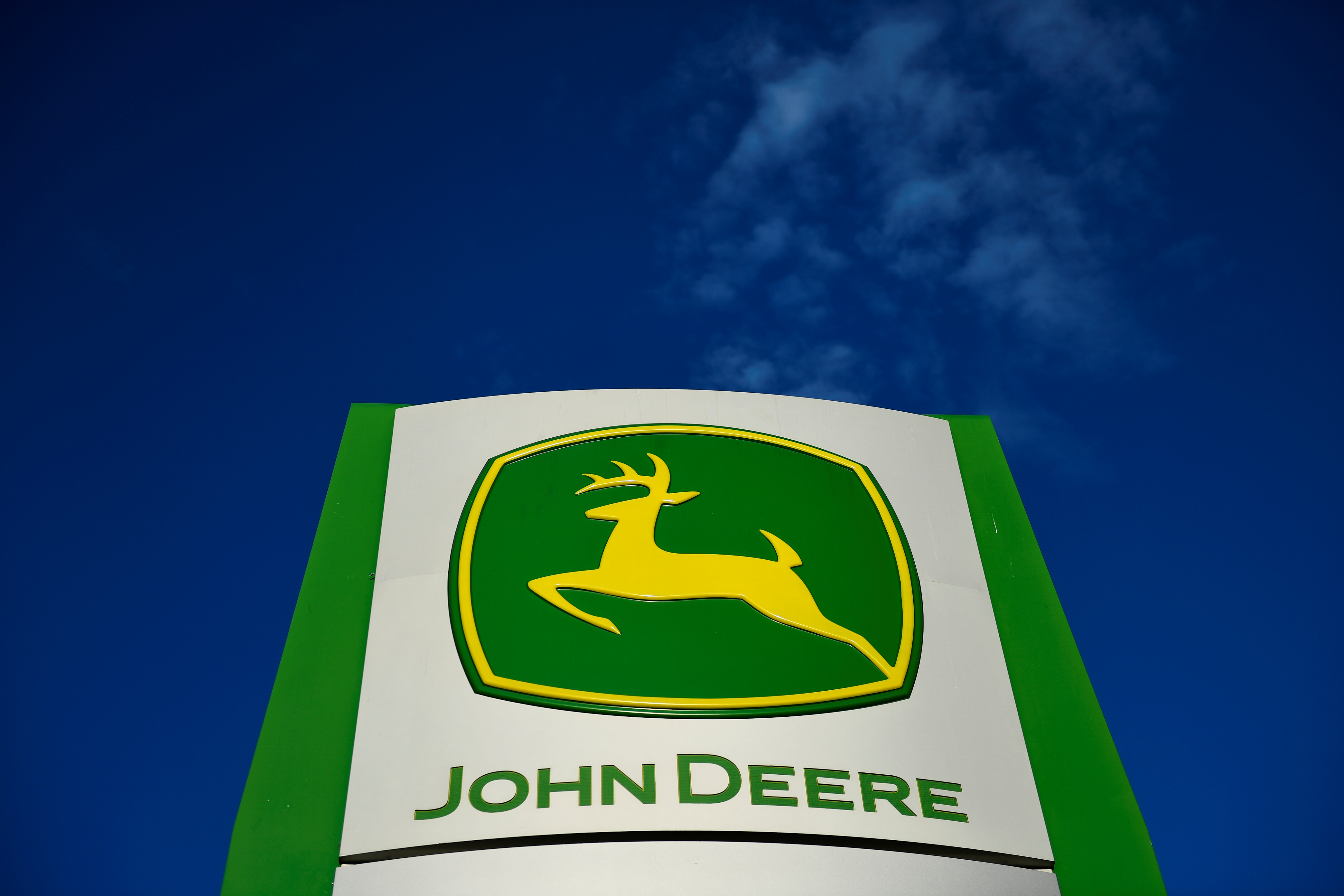 The leaping deer trademark logo is seen on a sign outside a John Deere dealership in Taylor, Texas, U.S., February 16, 2017. Picture taken February 16, 2017. REUTERS/Mohammad Khursheed