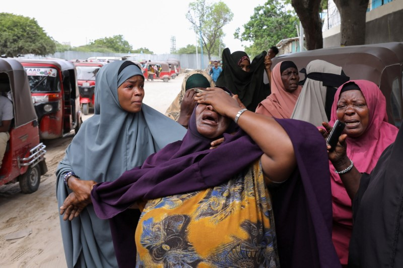 A woman reacts after receiving the confirmation that her son was killed in a suicide bombing attack on a military base, at the Madina Hospital in Mogadishu, Somalia June 15, 2021. REUTERS/Feisal Omar