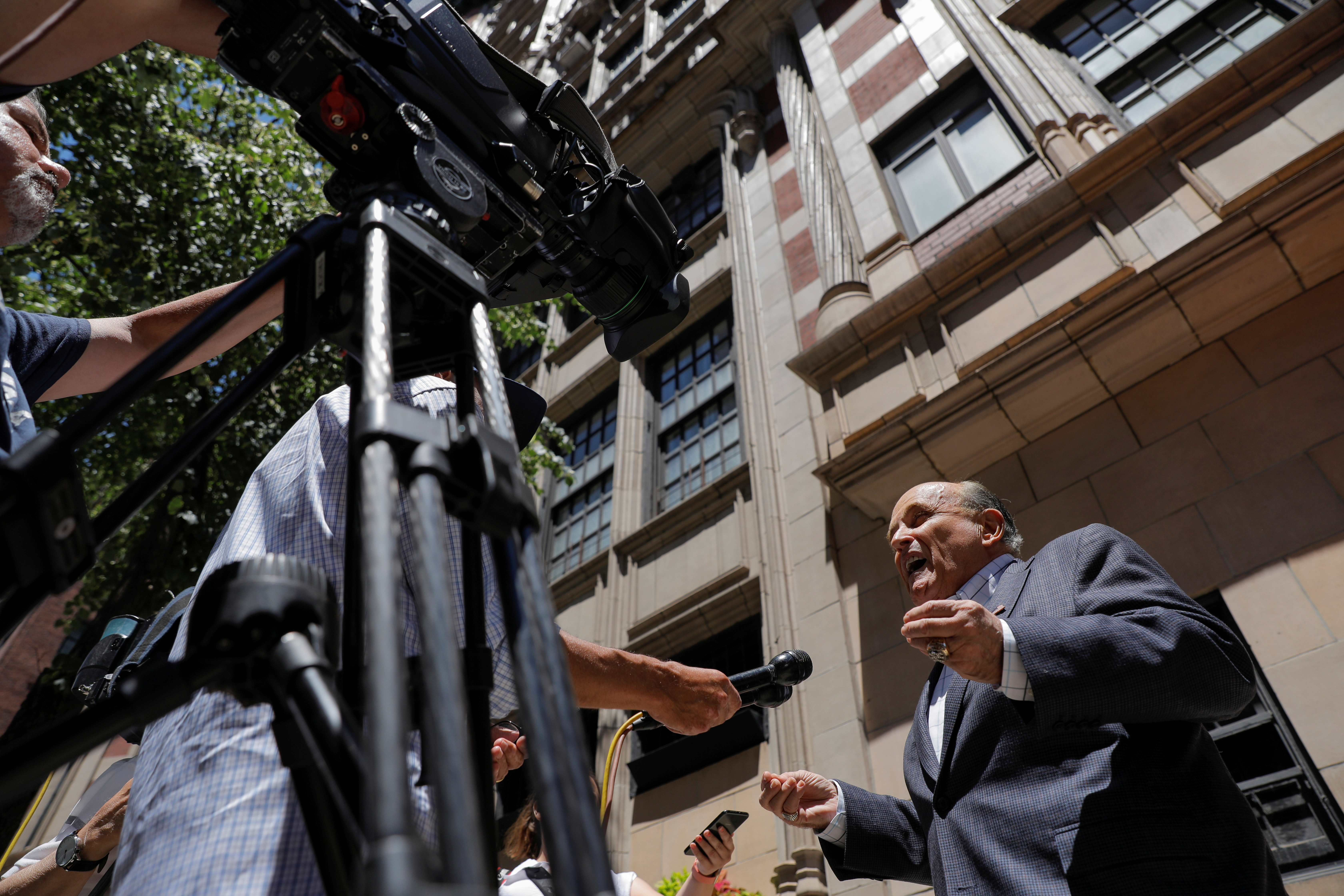 Former New York City Mayor Rudy Giuliani speaks to media outside his apartment building after the suspension of his law license in Manhattan in New York City, New York, U.S., June 24, 2021. REUTERS/Andrew Kelly