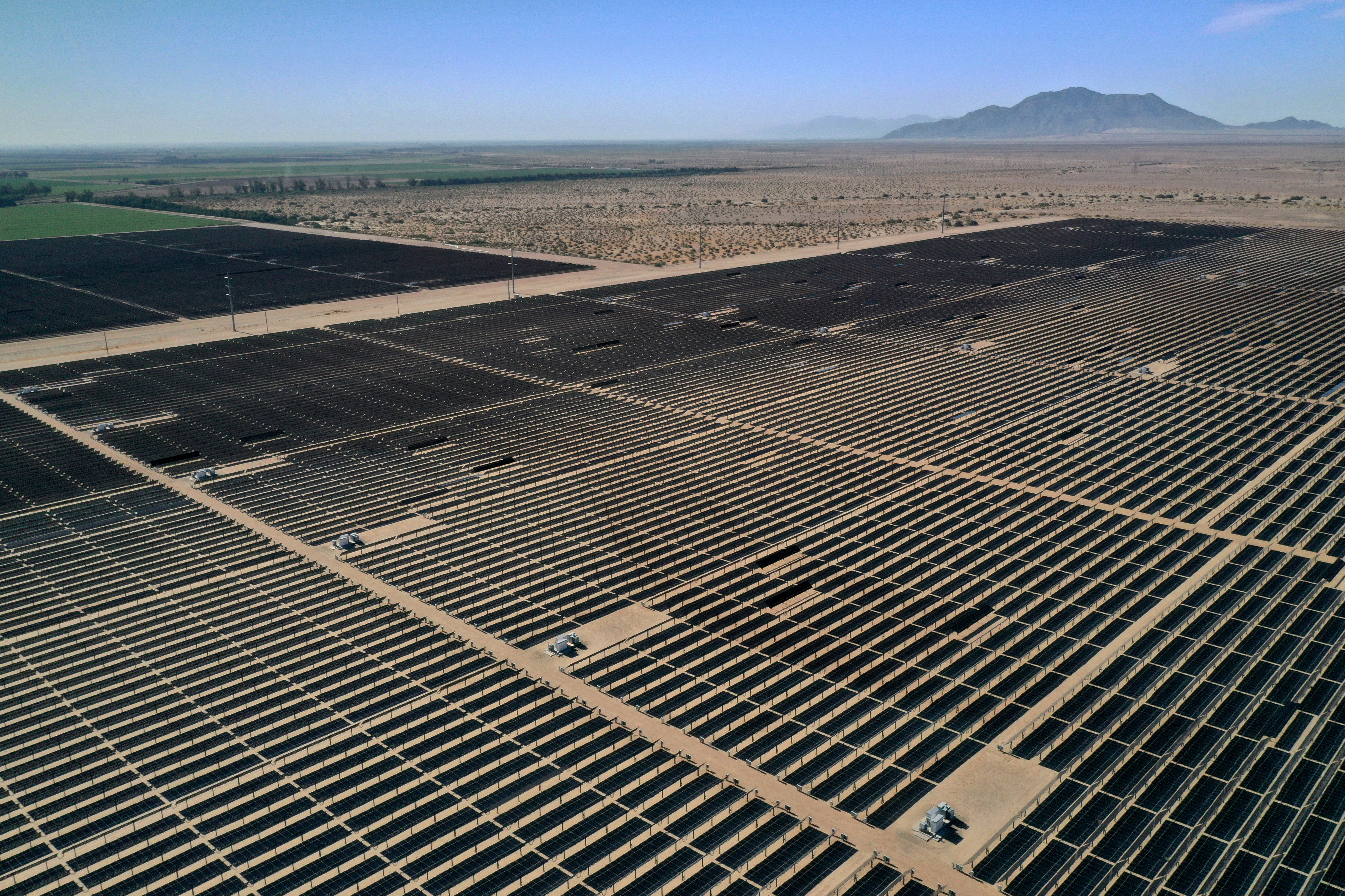 Arrays of photovoltaic solar panels are seen at the Tenaska Imperial Solar Energy Center South as the spread of the coronavirus disease (COVID-19) continues in this aerial photo taken over El Centro, California, U.S., May 29, 2020. Picture taken with a drone. REUTERS/Bing Guan