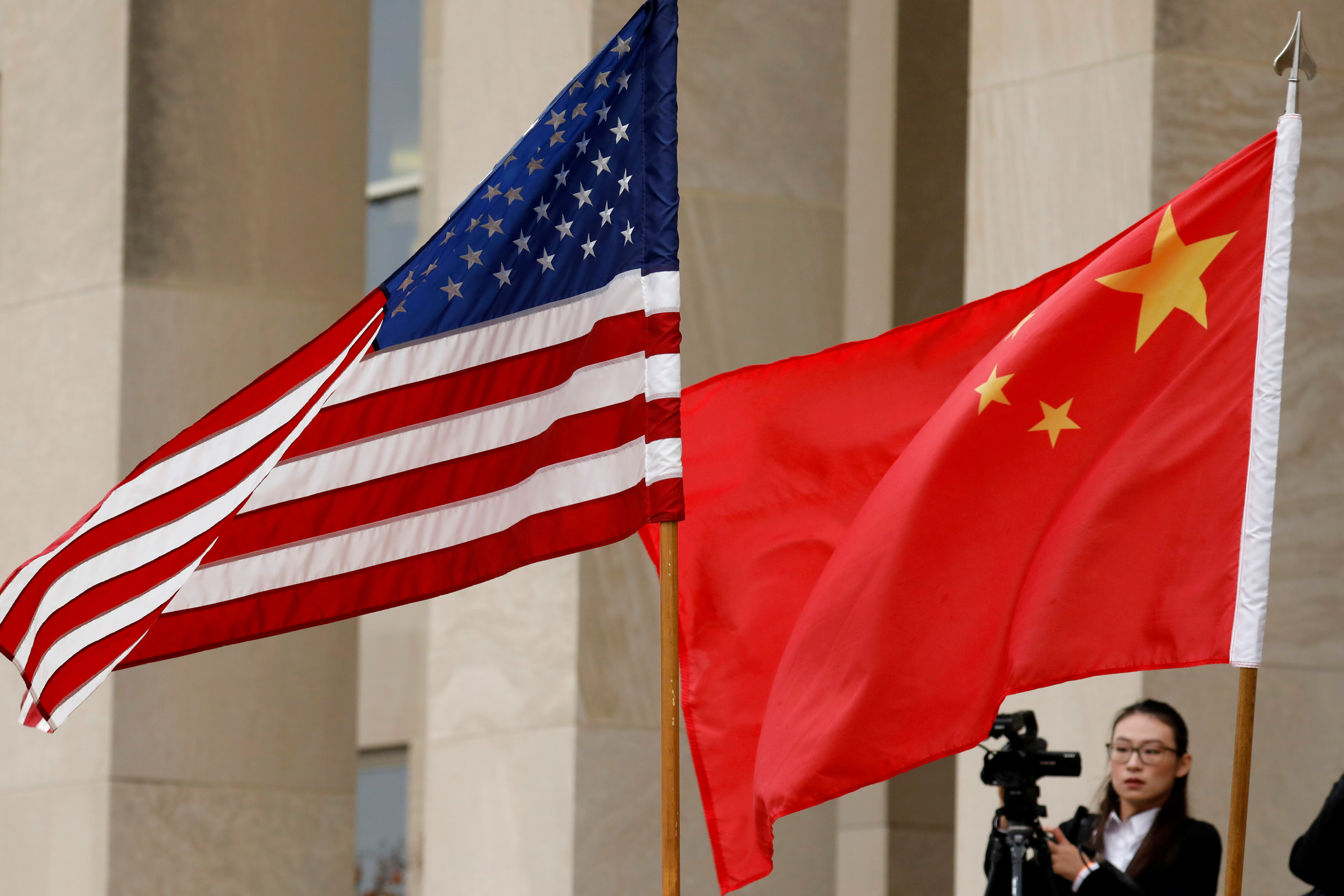 U.S. and Chinese flags are seen before a meeting between senior defence officials from both countries at the Pentagon in Arlington, Virginia, U.S., November 9, 2018. REUTERS/Yuri Gripas/File Photo