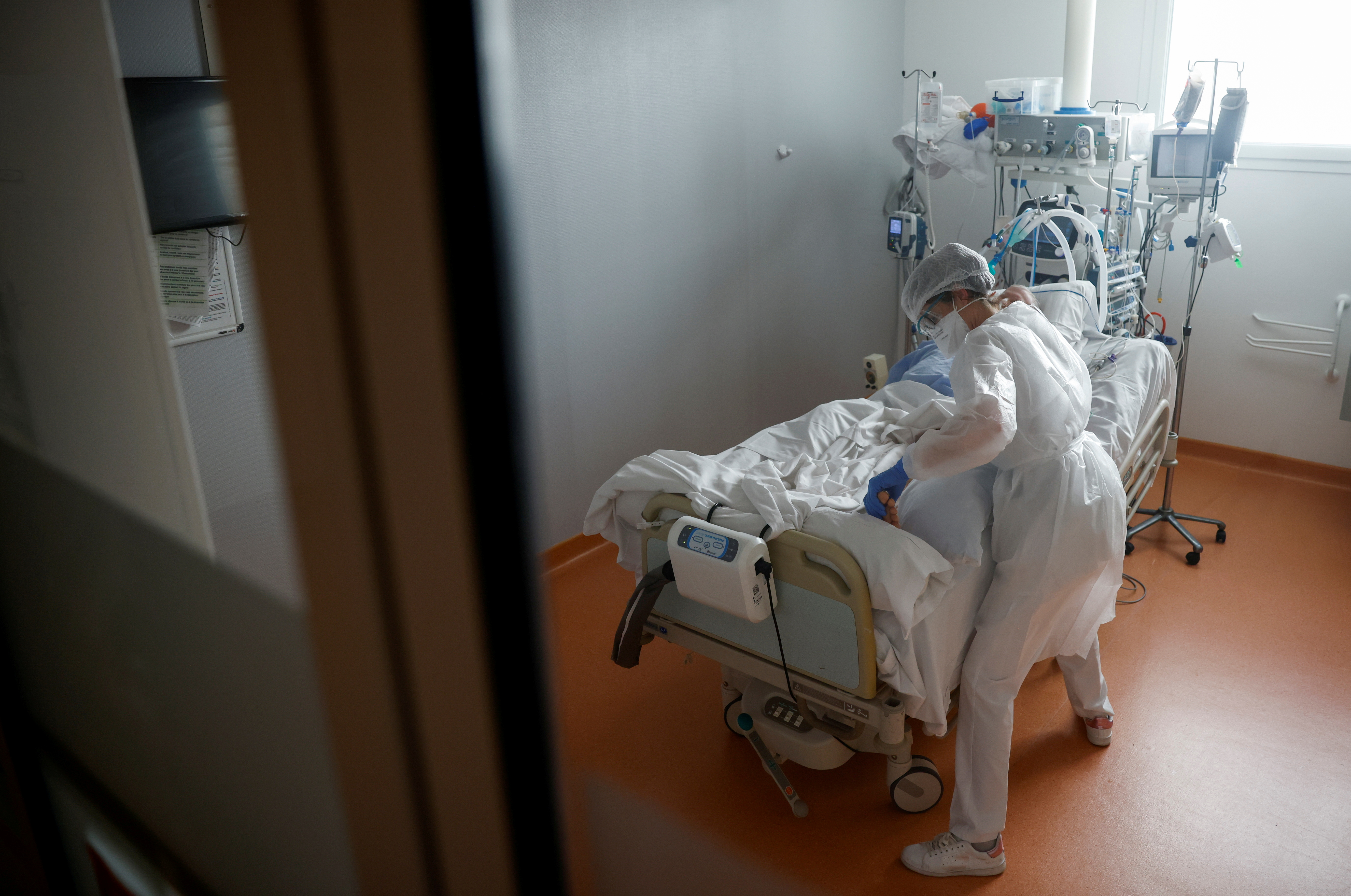 A medical staff member works in the Intensive Care Unit (ICU) where patients suffering from the coronavirus disease (COVID-19) are treated at ELSAN's private hospital Clinique Oceane in Vannes, France, April 7, 2021. REUTERS/Stephane Mahe