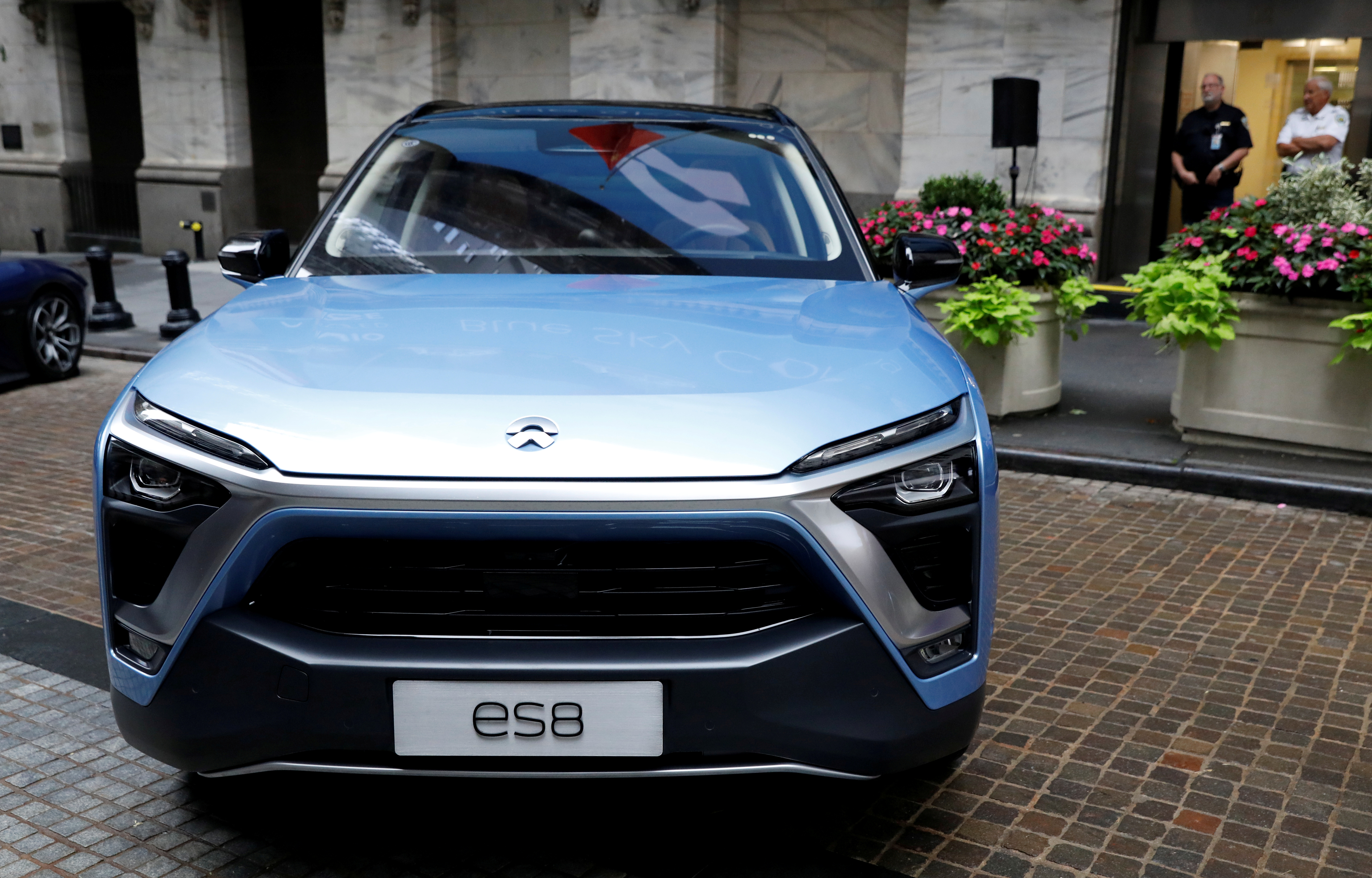 Chinese electric vehicle start-up Nio Inc. vehicles are on display in front of the New York Stock Exchange (NYSE) to celebrate the company's initial public offering (IPO) in New York, U.S., September 12, 2018.  REUTERS/Brendan McDermid/File Photo