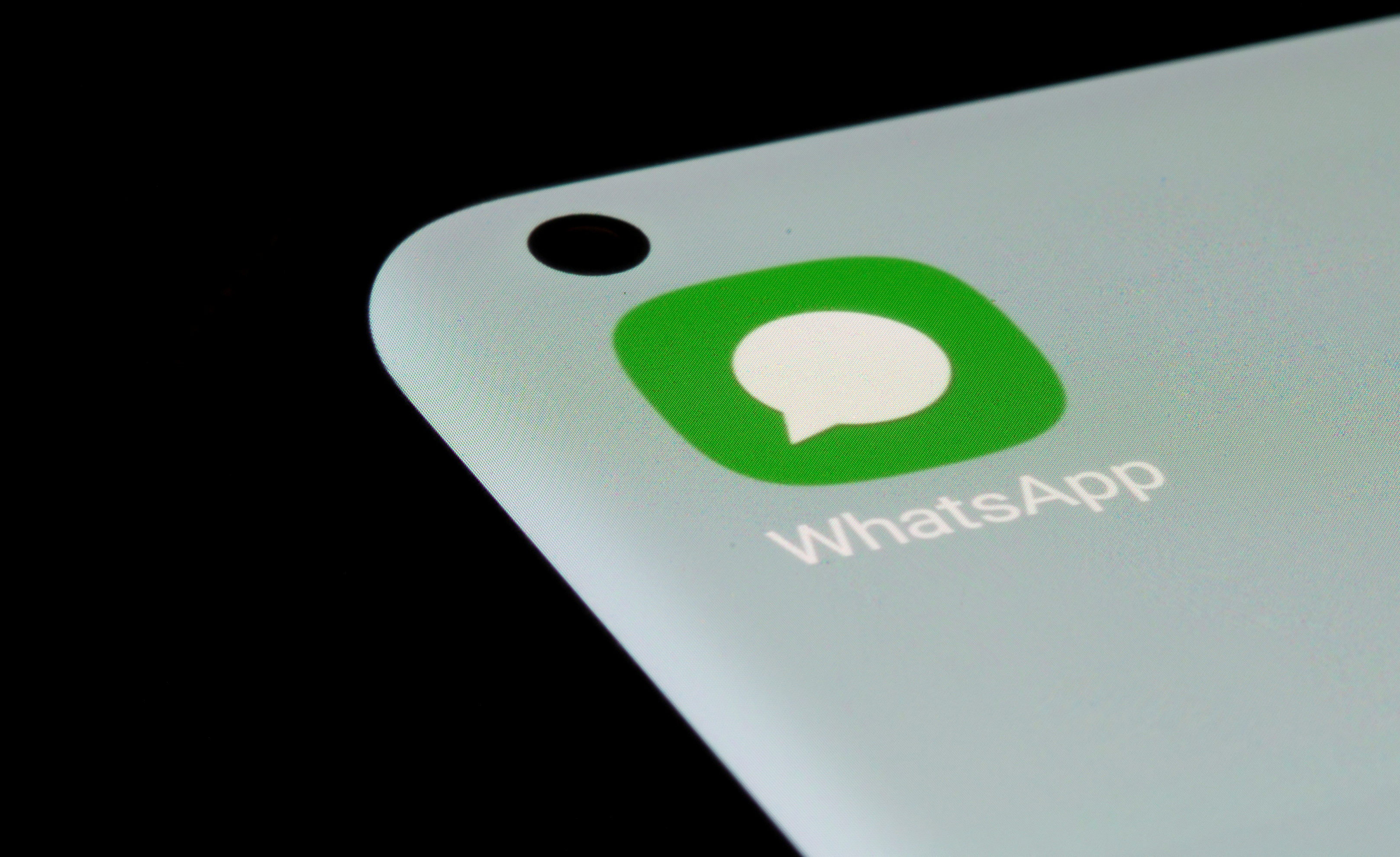 WhatsApp app is seen on a smartphone in this illustration taken, July 13, 2021. REUTERS/Dado Ruvic/Illustration/File Photo