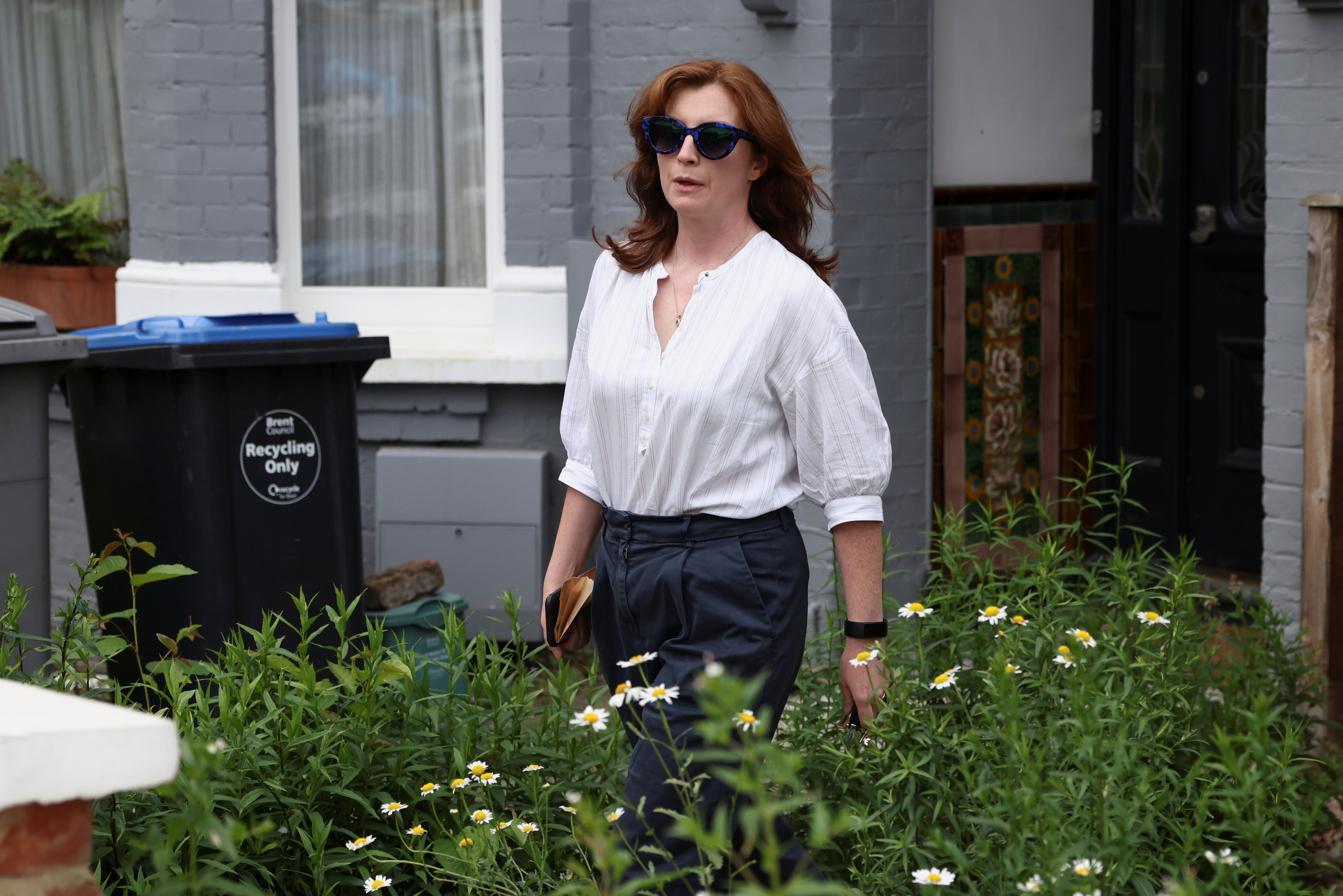 Martha Hancock, the wife of Britain's Health Secretary Matt Hancock, leaves her home in London, Britain, June 25, 2021. REUTERS/Henry Nicholls