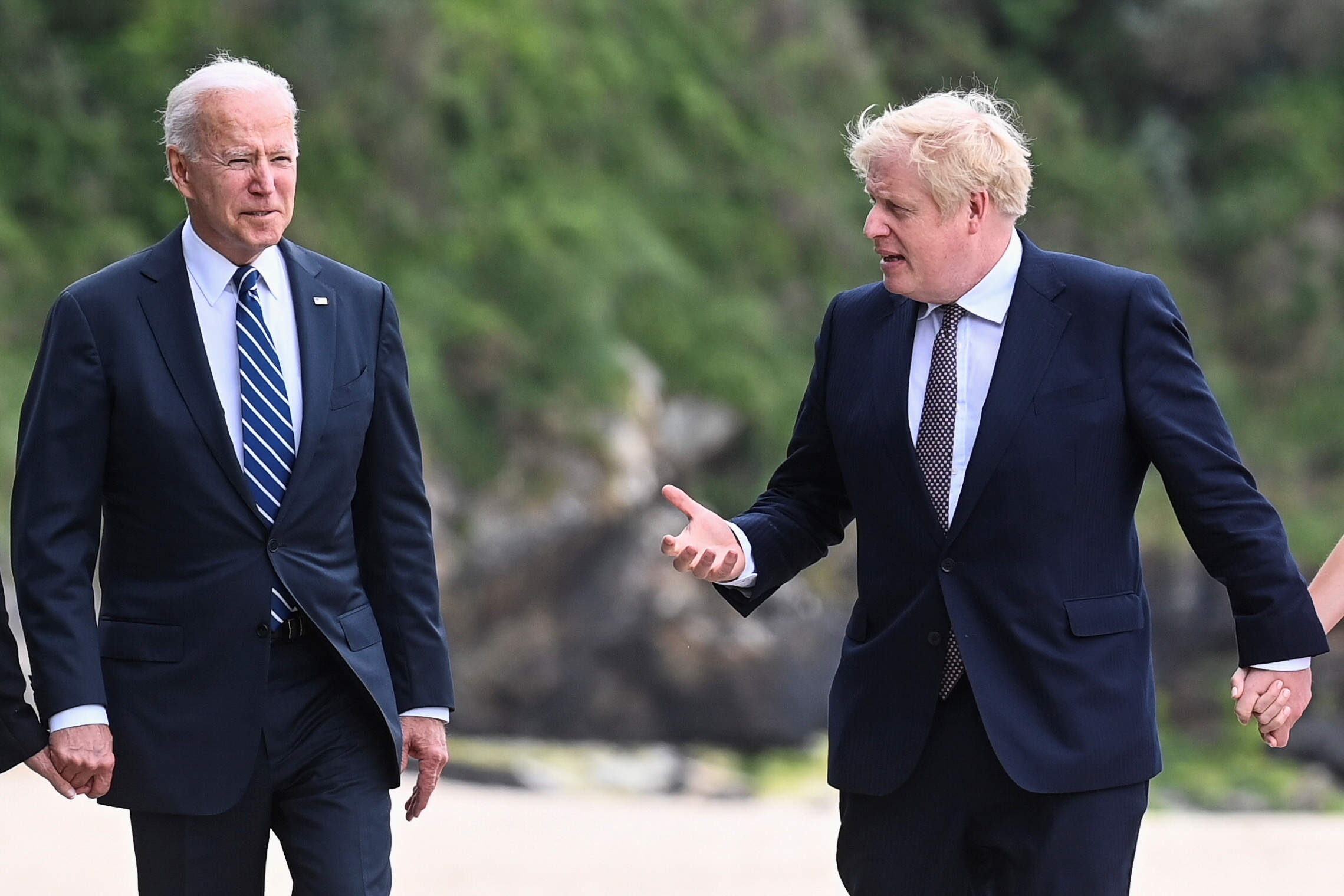 Britain's Prime Minister Boris Johnson speaks with U.S. President Joe Biden while they walk with their wife Carrie Johnson (not seen) and U.S. first lady Jill Biden (not seen), outside Carbis Bay Hotel, Carbis Bay, Cornwall, Britain June 10, 2021. REUTERS/Toby Melville/Pool