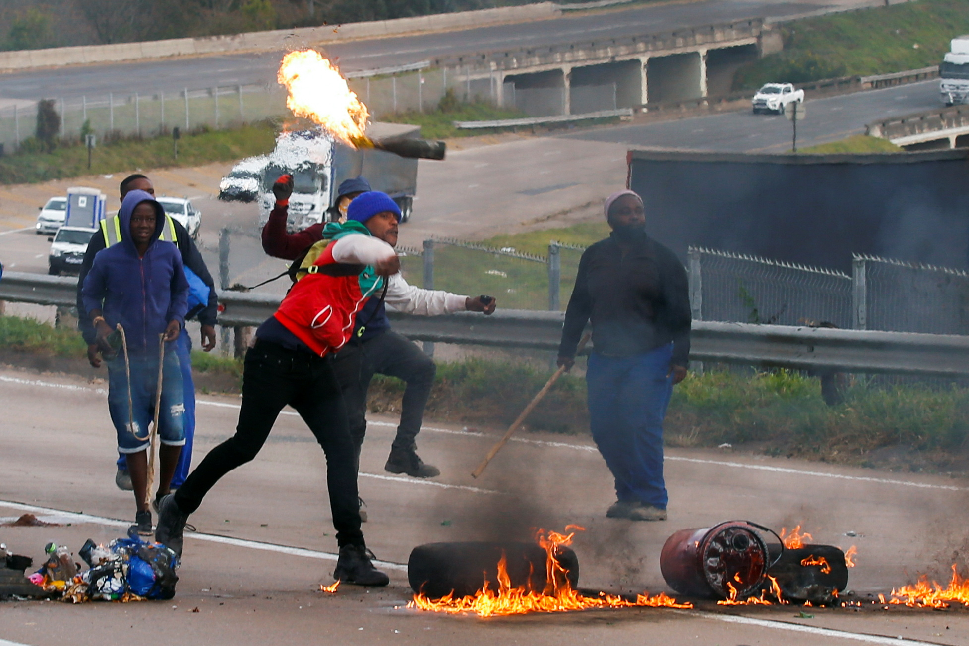 Supporters of former South African President Jacob Zuma block a freeway with burning tyres during a protest in Peacevale, South Africa, July 9, 2021. REUTERS/Rogan Ward
