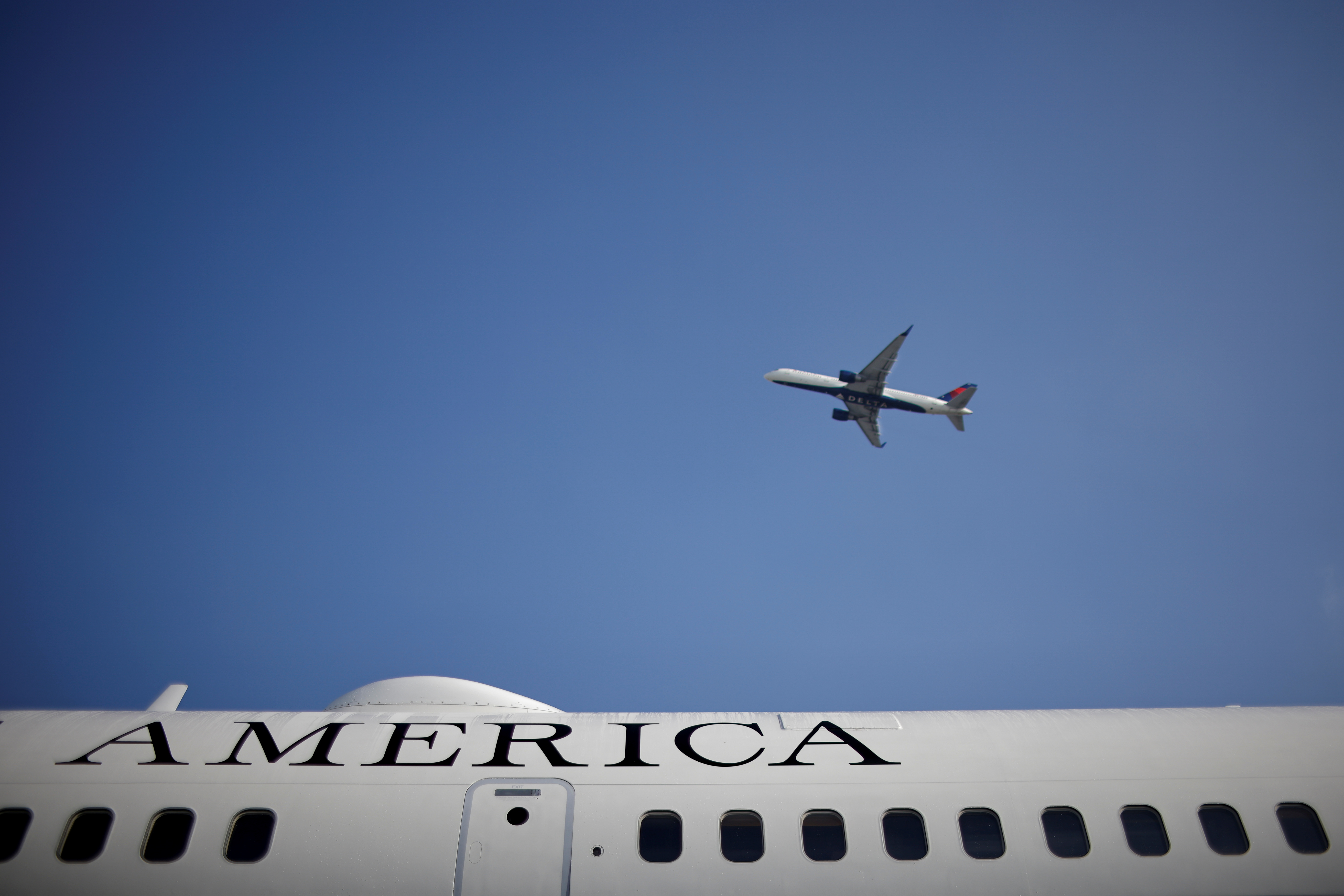 A Delta plane is seen from the Los Angeles International Airport (LAX), in Los Angeles, California, U.S., April 5, 2021. REUTERS/Carlos Barria