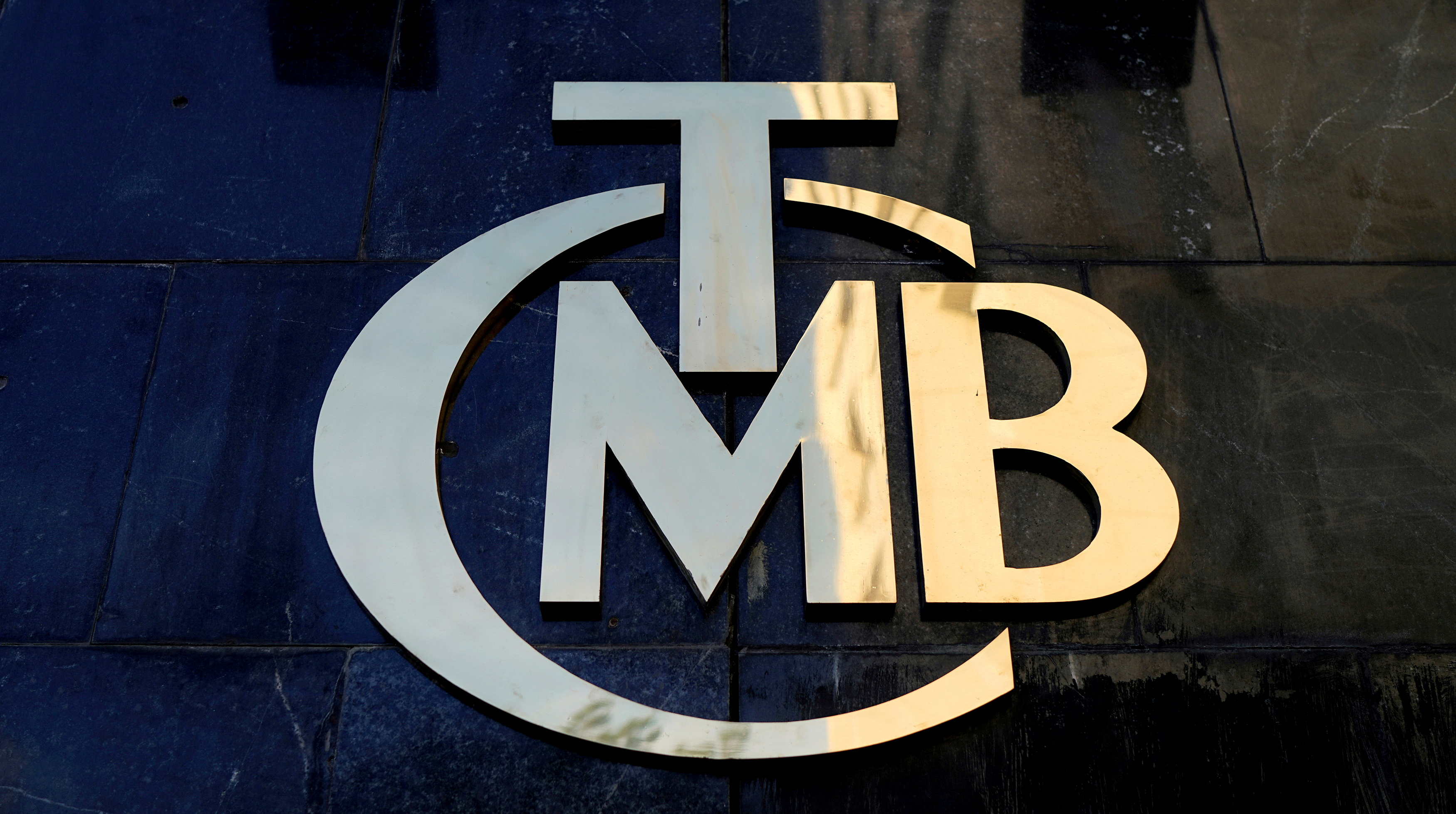 A logo of Turkey's Central Bank (TCMB) is pictured at the entrance of the bank's headquarters in Ankara, Turkey April 19, 2015. REUTERS/Umit Bektas///File Photo
