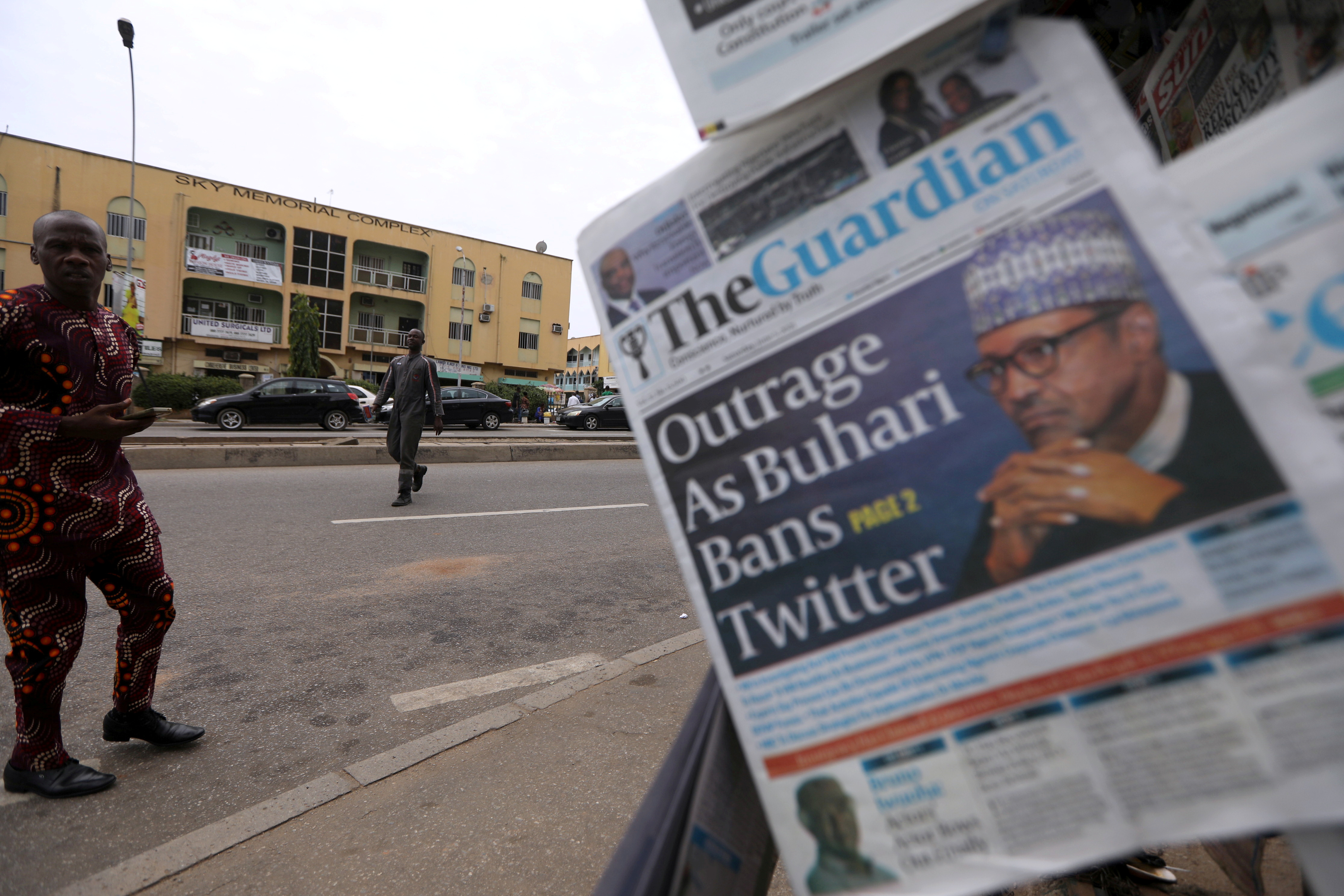 A man looks at newspapers at a newsstand in Abuja, Nigeria June 5, 2021. REUTERS/Afolabi Sotunde