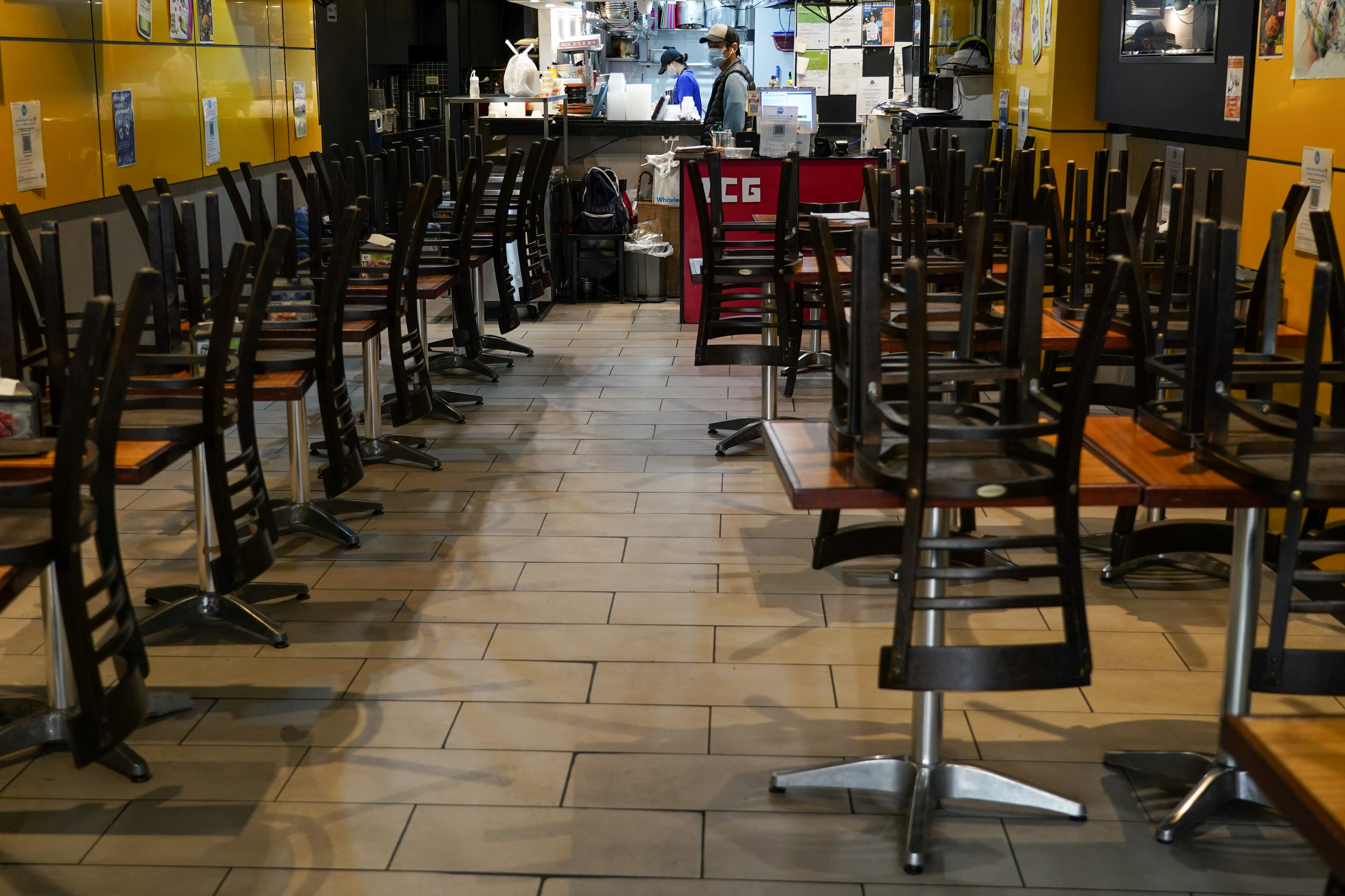 Chairs are stacked on tables inside a city centre restaurant serving takeaway but closed for dine-in during a lockdown to curb the spread of a coronavirus disease (COVID-19) outbreak in Sydney, Australia, July 12, 2021.  REUTERS/Loren Elliott