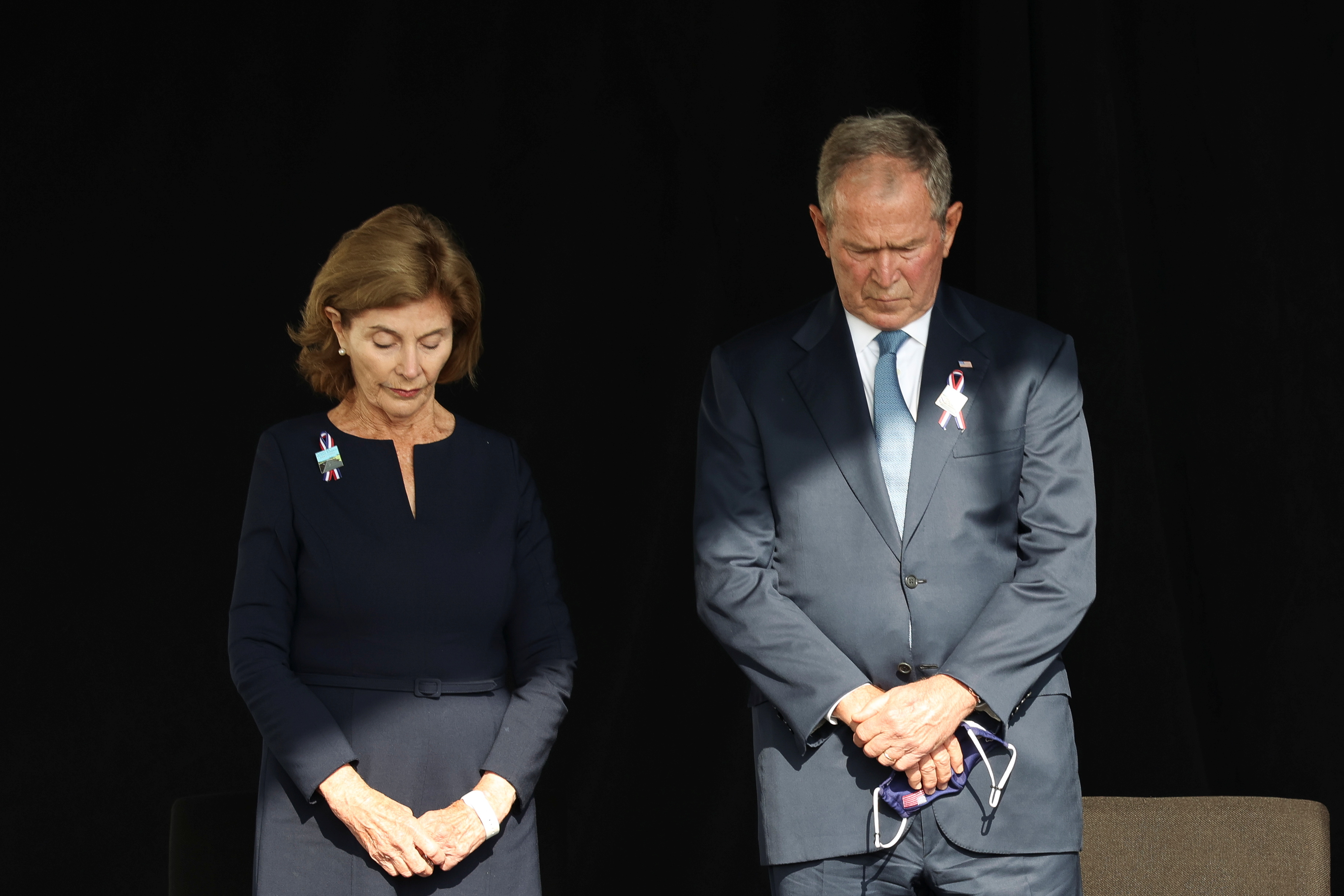Former U.S. President George W. Bush and his wife Laura attend an event commemorating the 20th anniversary of the September 11, 2001 attacks at the Flight 93 National Memorial in Stoystown, Pennsylvania, U.S., September 11, 2021. REUTERS/Hannah Beier