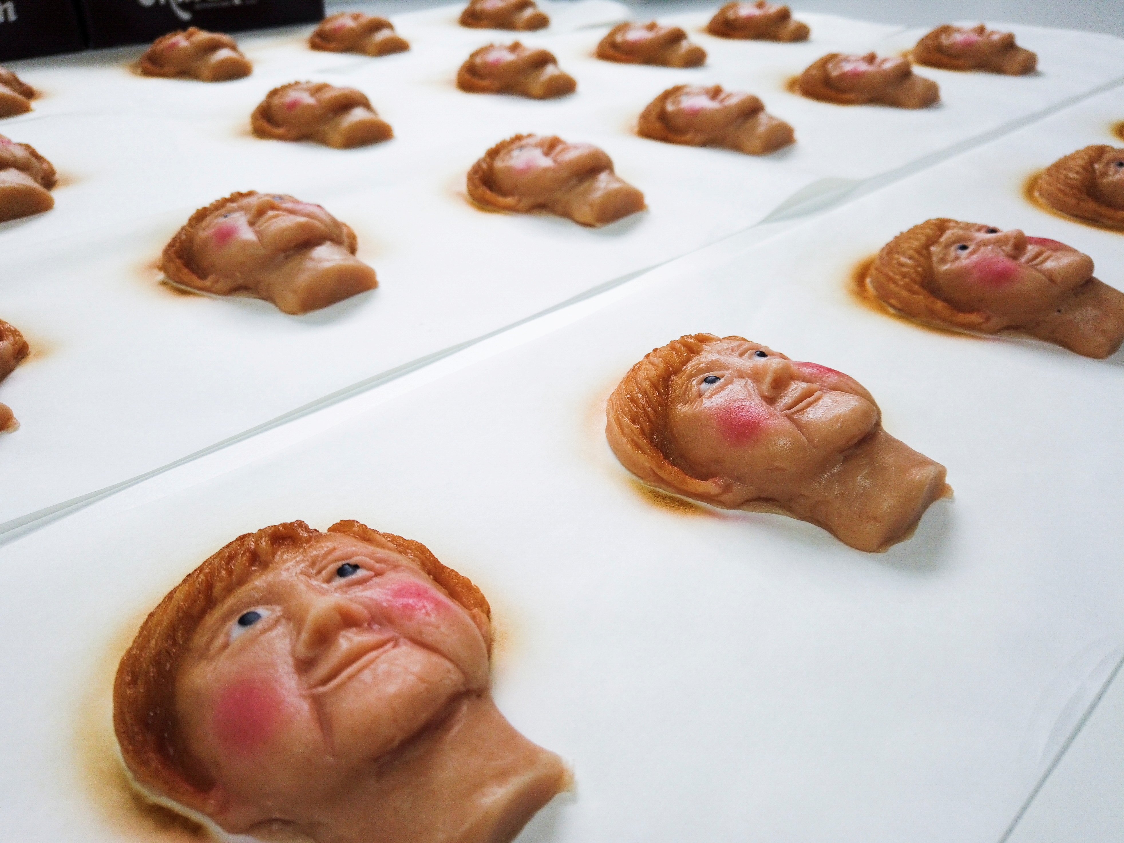 Marzipan cookies depicting German Chancellor Angela Merkel made by a German confectioner ahead of the September 26 elections, are displayed in Weilbach, Germany, September 14, 2021. REUTERS/Annkathrin Weis