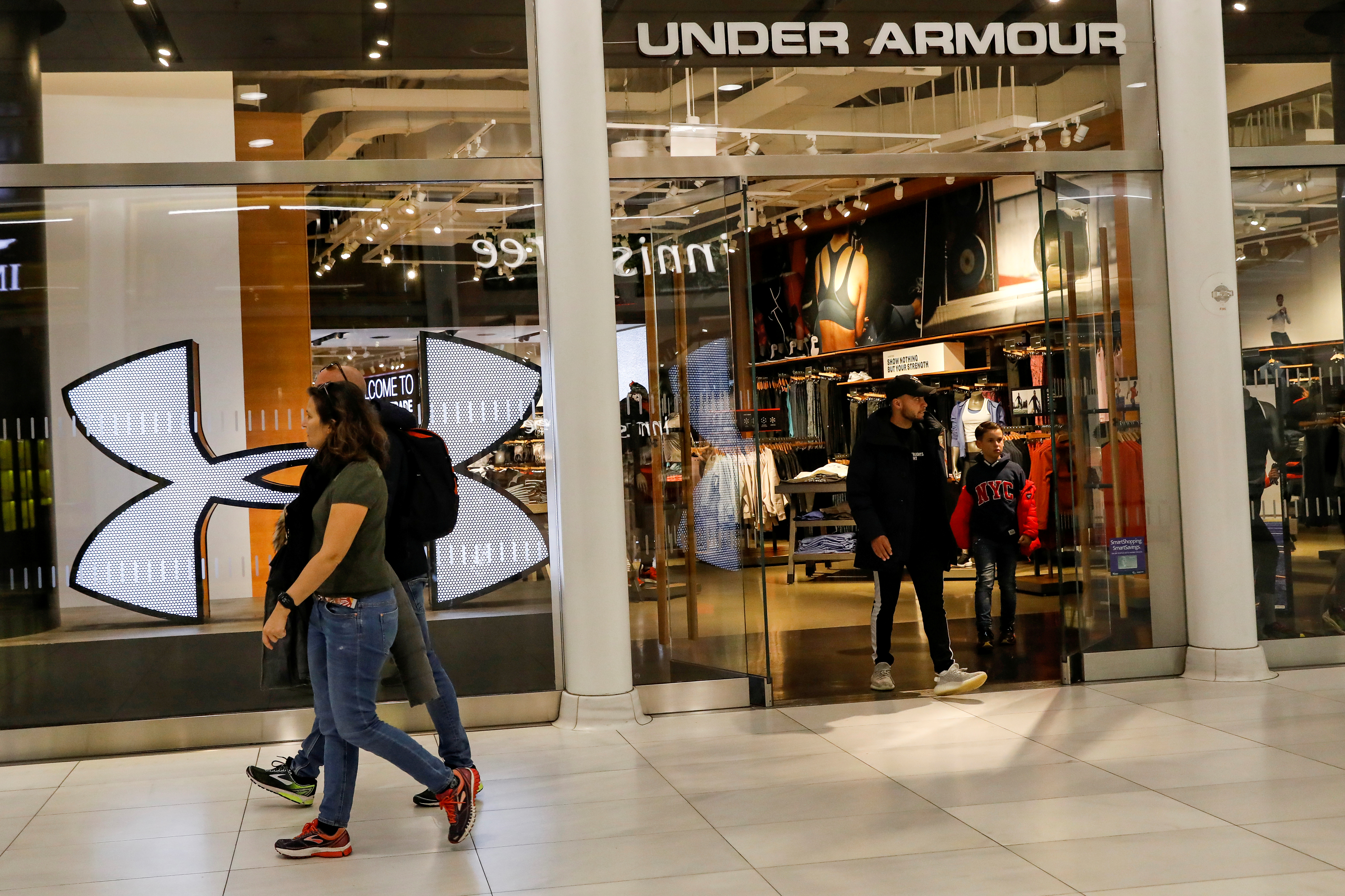 Customers exit an Under Armour store in New York City, U.S., November 4, 2019. REUTERS/Brendan McDermid