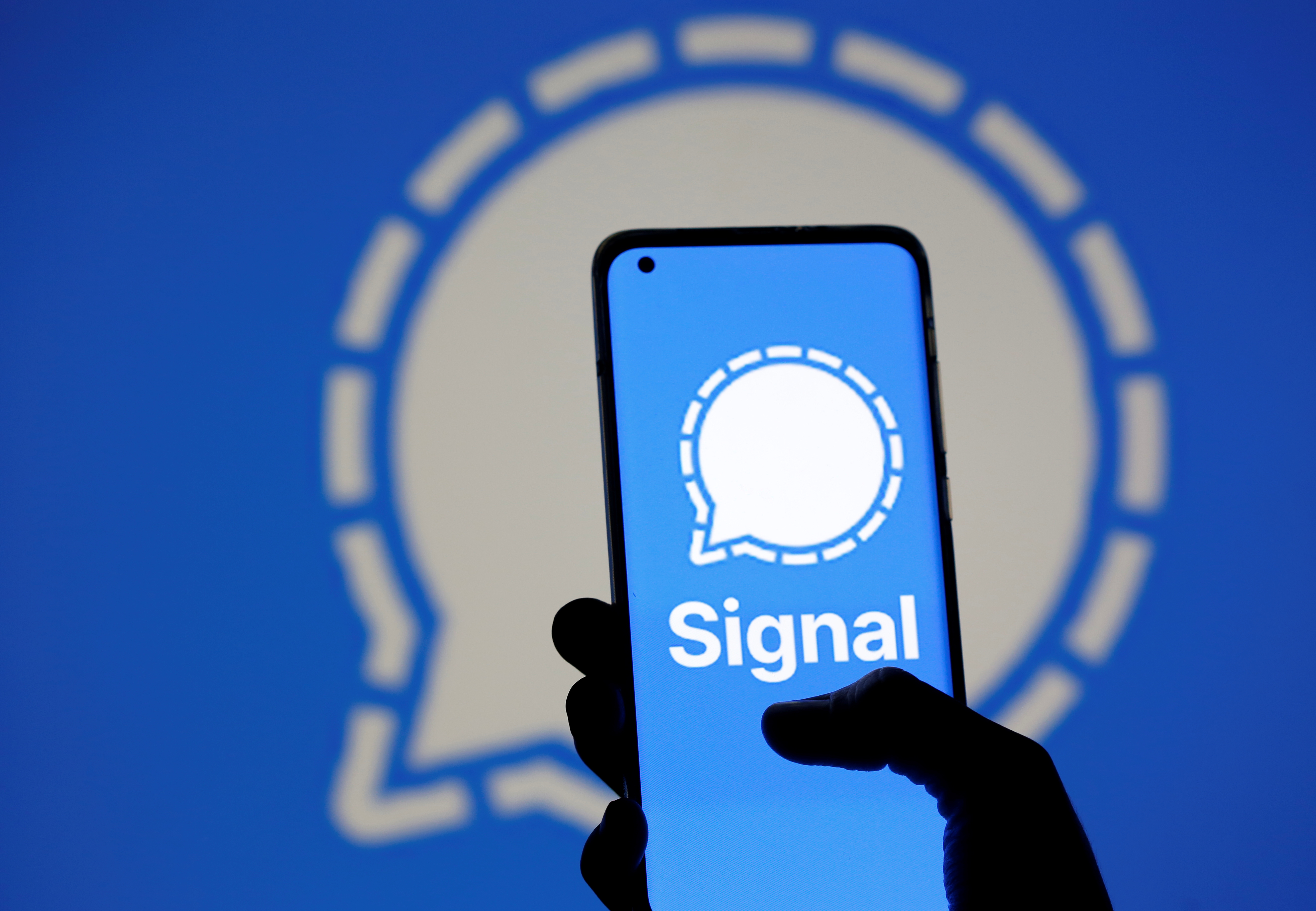 The Signal messaging app logo is seen on a smartphone, in front of the same displayed same logo, in this illustration taken, January 13, 2021. REUTERS/Dado Ruvic