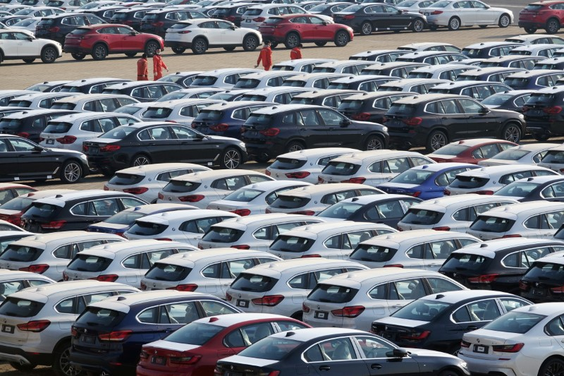 Newly manufactured cars are seen at a port in Dalian, Liaoning province, China April 10, 2020. China Daily via REUTERS