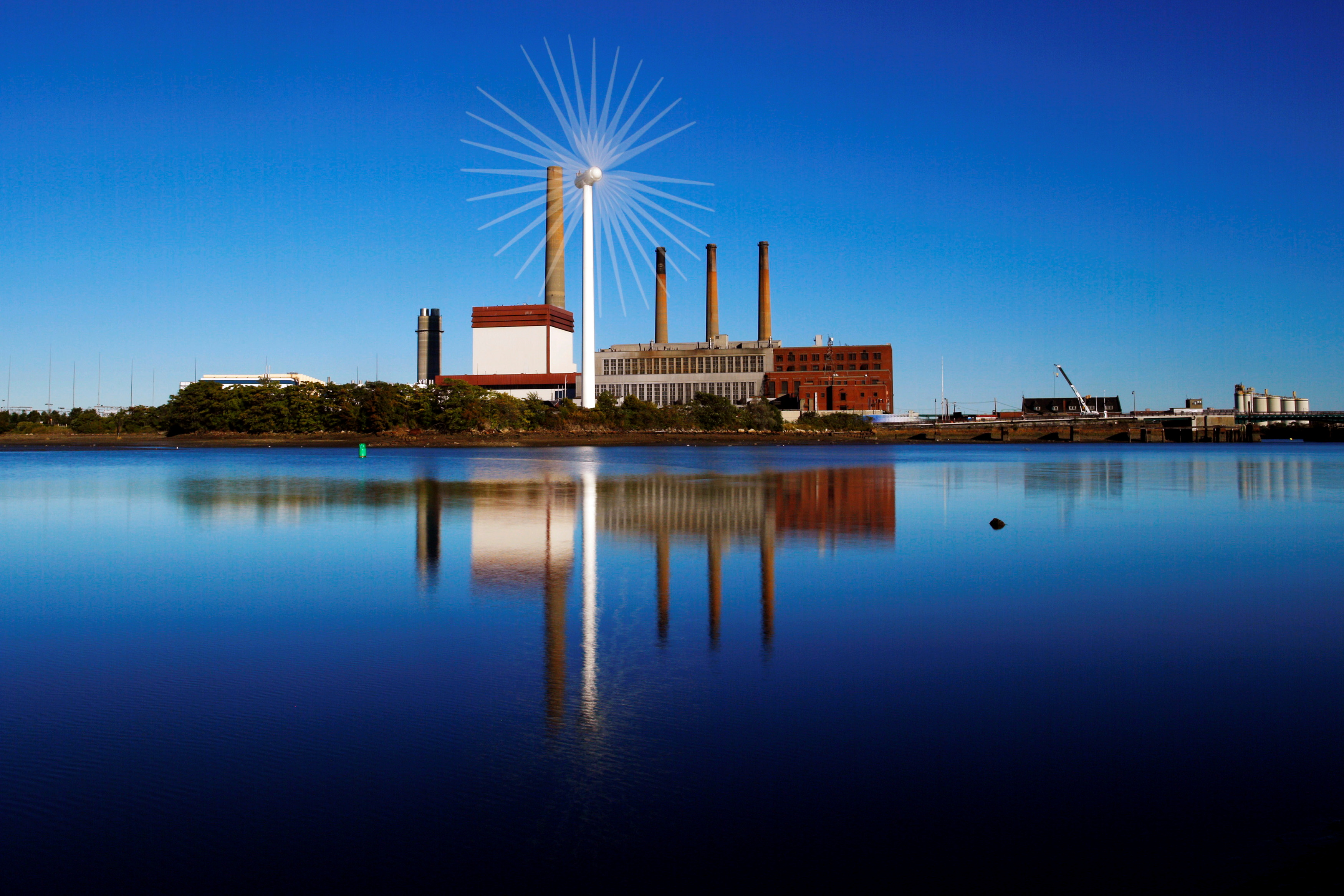 A Massachusetts Water Resources Authority wind turbine turns in front of a 1951 megawatt fossil fuel power plant in Charlestown, Massachusetts September 18, 2013.   The wind turbine powers the MWRA waste water pumping station at that site and the power plant uses natural gas and oil.  This is an in-camera, multiple exposure photograph.  REUTERS/Brian Snyder/File Photo