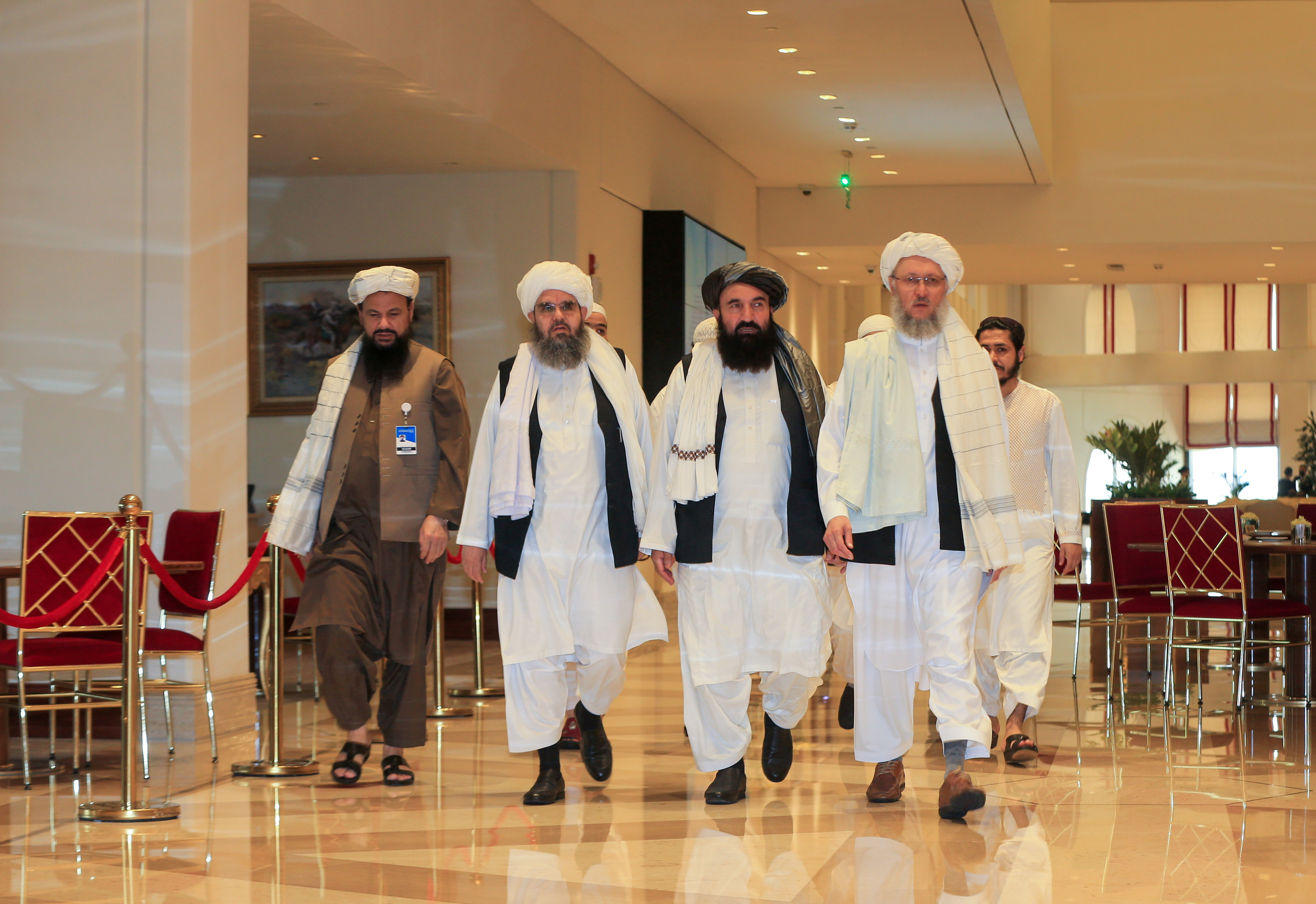 Abdul Salam Hanafi, member of the Taliban negotiating team and the Taliban delegation, arrive for Afghan peace talks in Doha, Qatar, August 12, 2021. REUTERS/Hussein Sayed