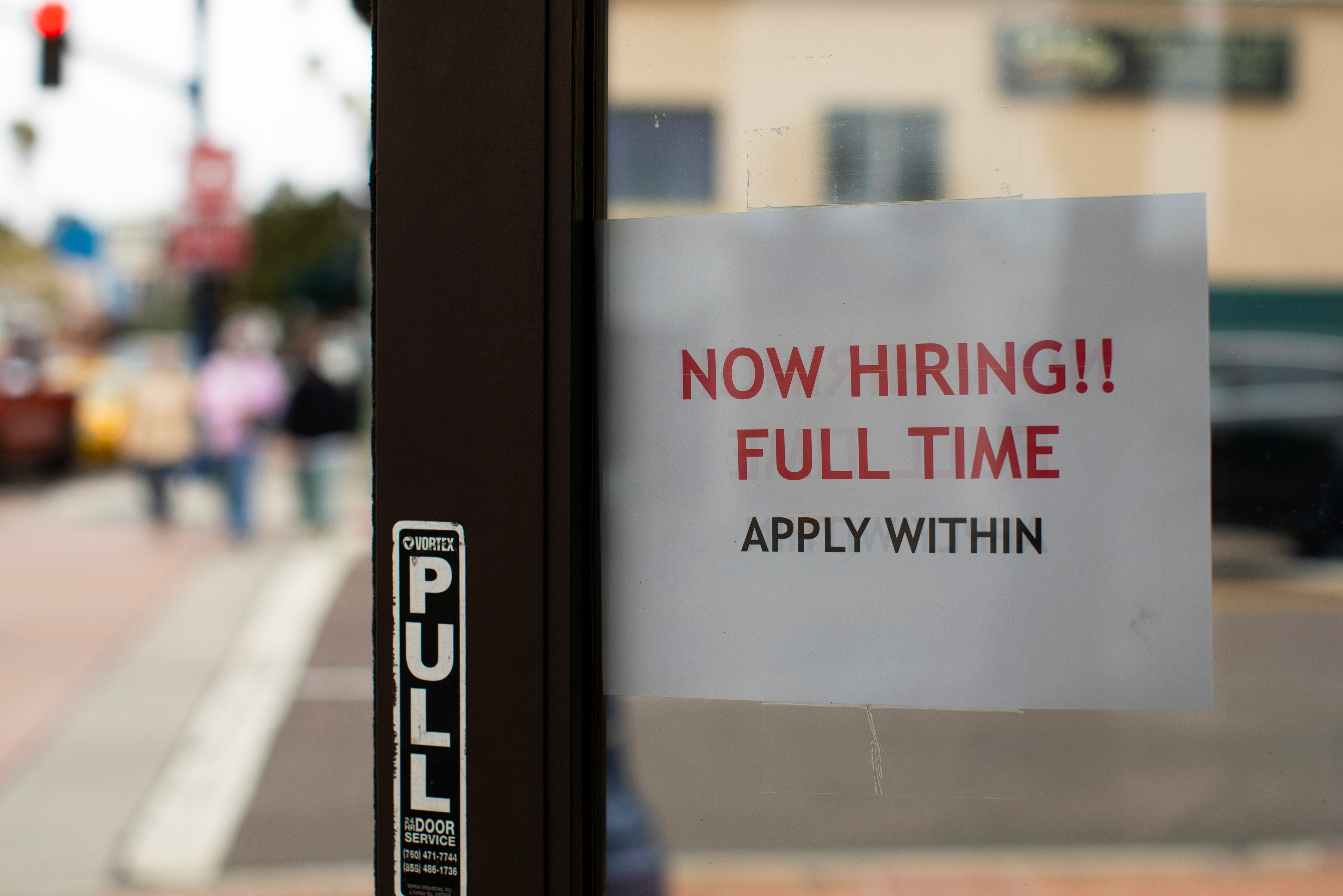 A retail store advertising a full time job on its open door in Oceanside, California, U.S., May 10, 2021. REUTERS/Mike Blake