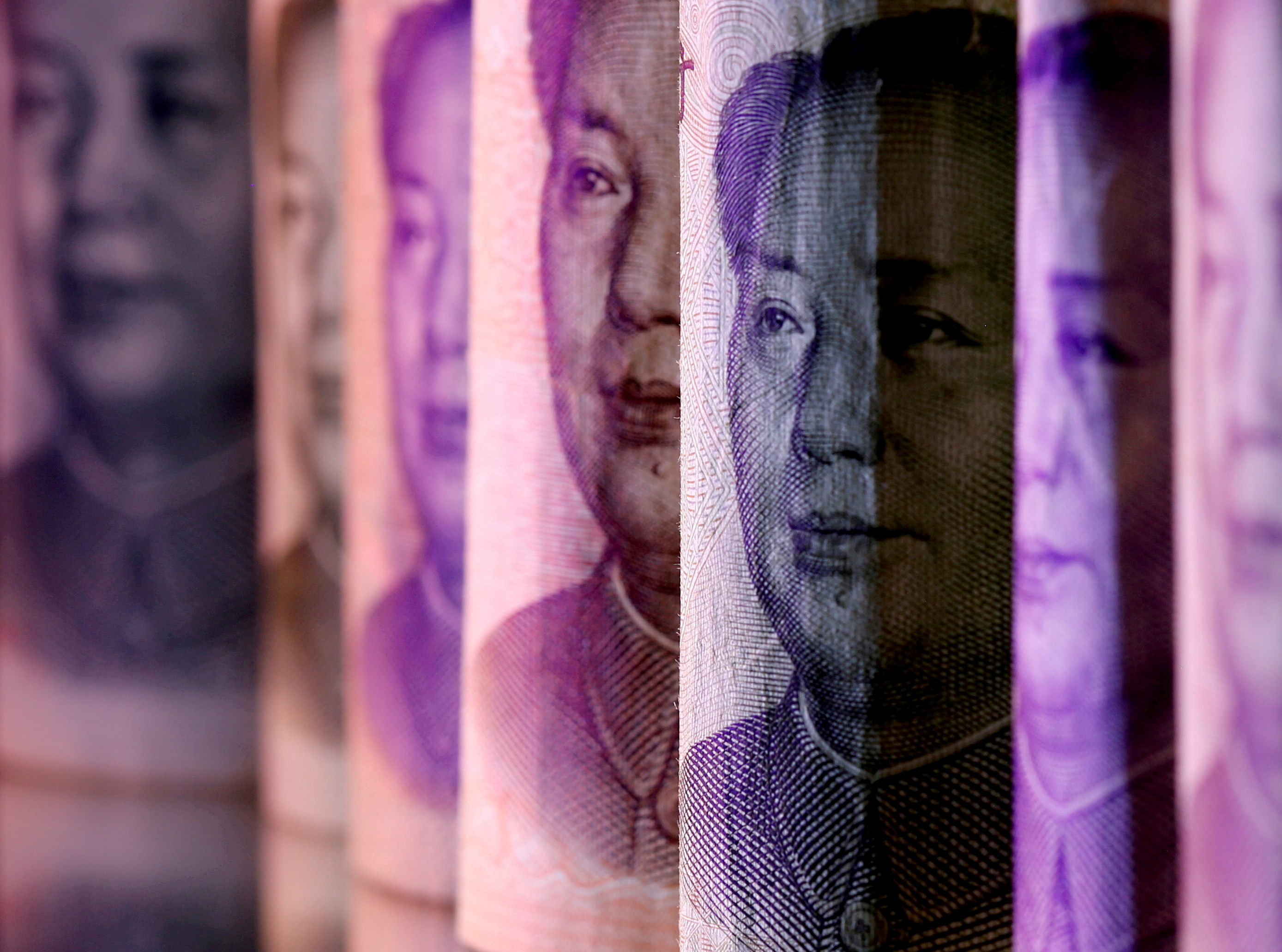 Chinese Yuan banknotes are seen in this illustration taken February 10, 2020. REUTERS/Dado Ruvic/Illustration/File Photo