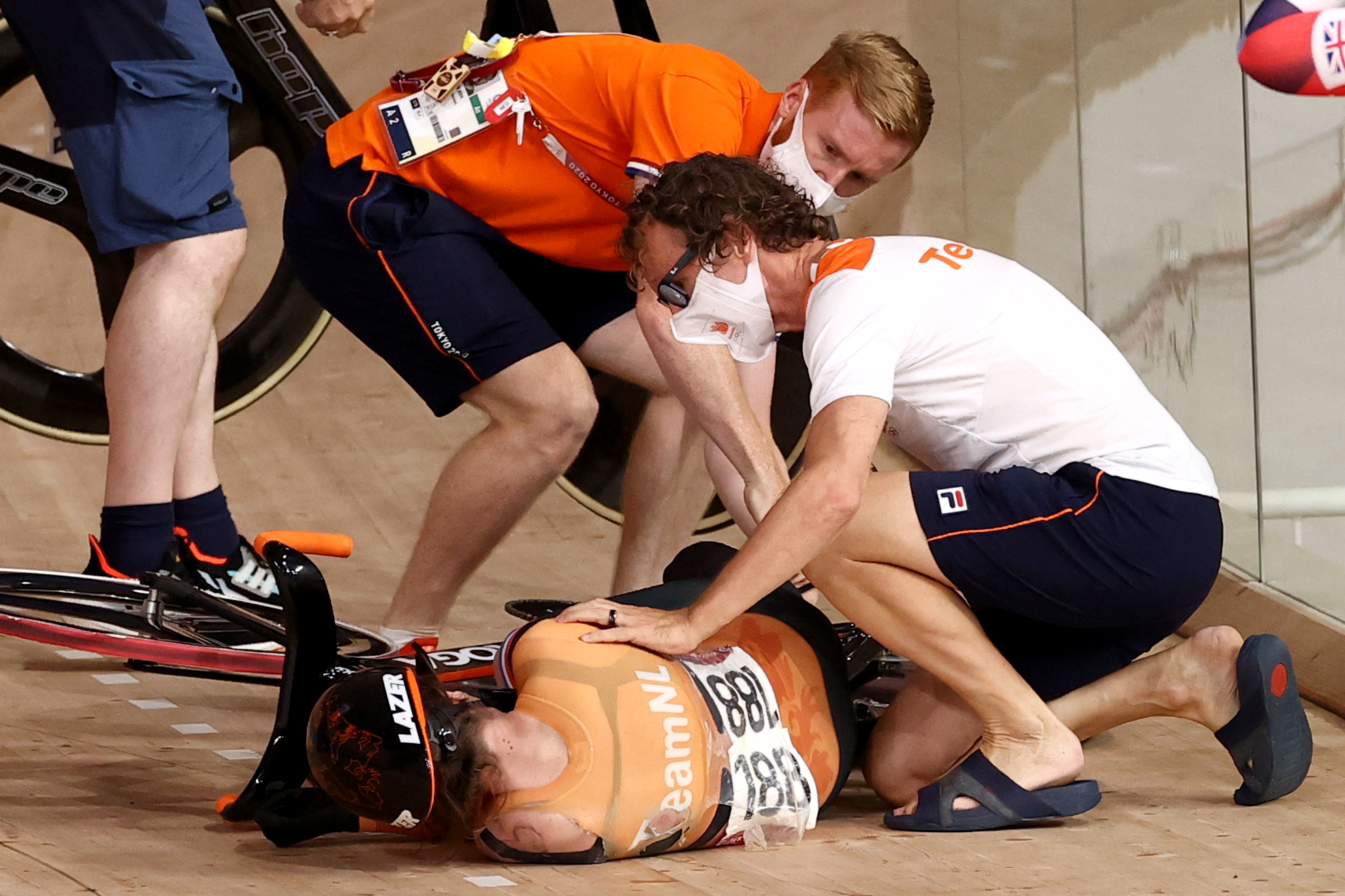 Tokyo 2020 Olympics - Cycling - Track - Women's Keirin - Quarterfinal - Izu Velodrome, Shizuoka, Japan - August 5, 2021.  Laurine van Riessen of the Netherlands receives medical attention after she crashes. REUTERS/Kacper Pempel