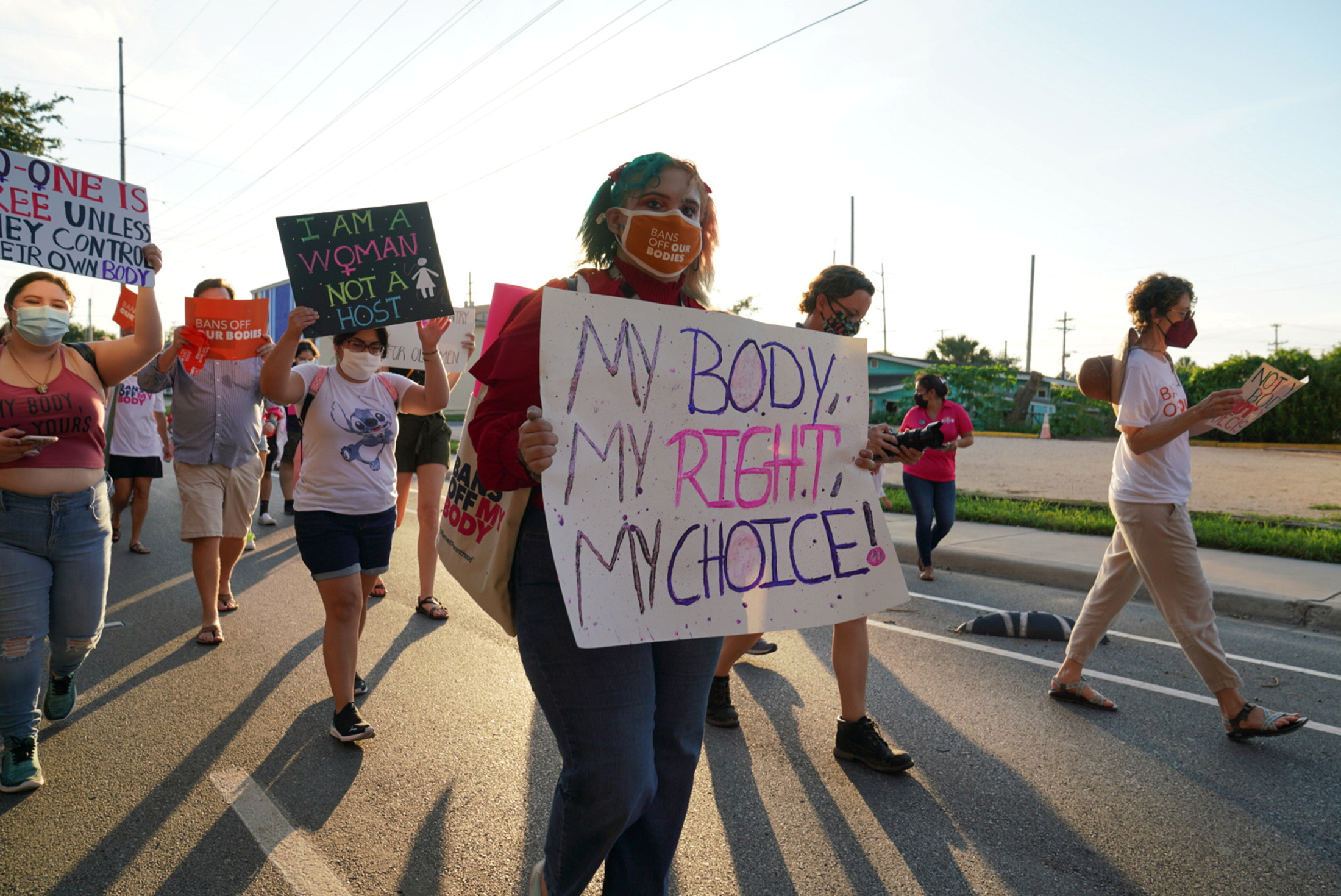 Supporters of reproductive choice take part in the nationwide Women's March, held after Texas rolled out a near-total ban on abortion procedures and access to abortion-inducing medications, in Brownsville, Texas, U.S. October 2, 2021. REUTERS/Veronica Cardenas