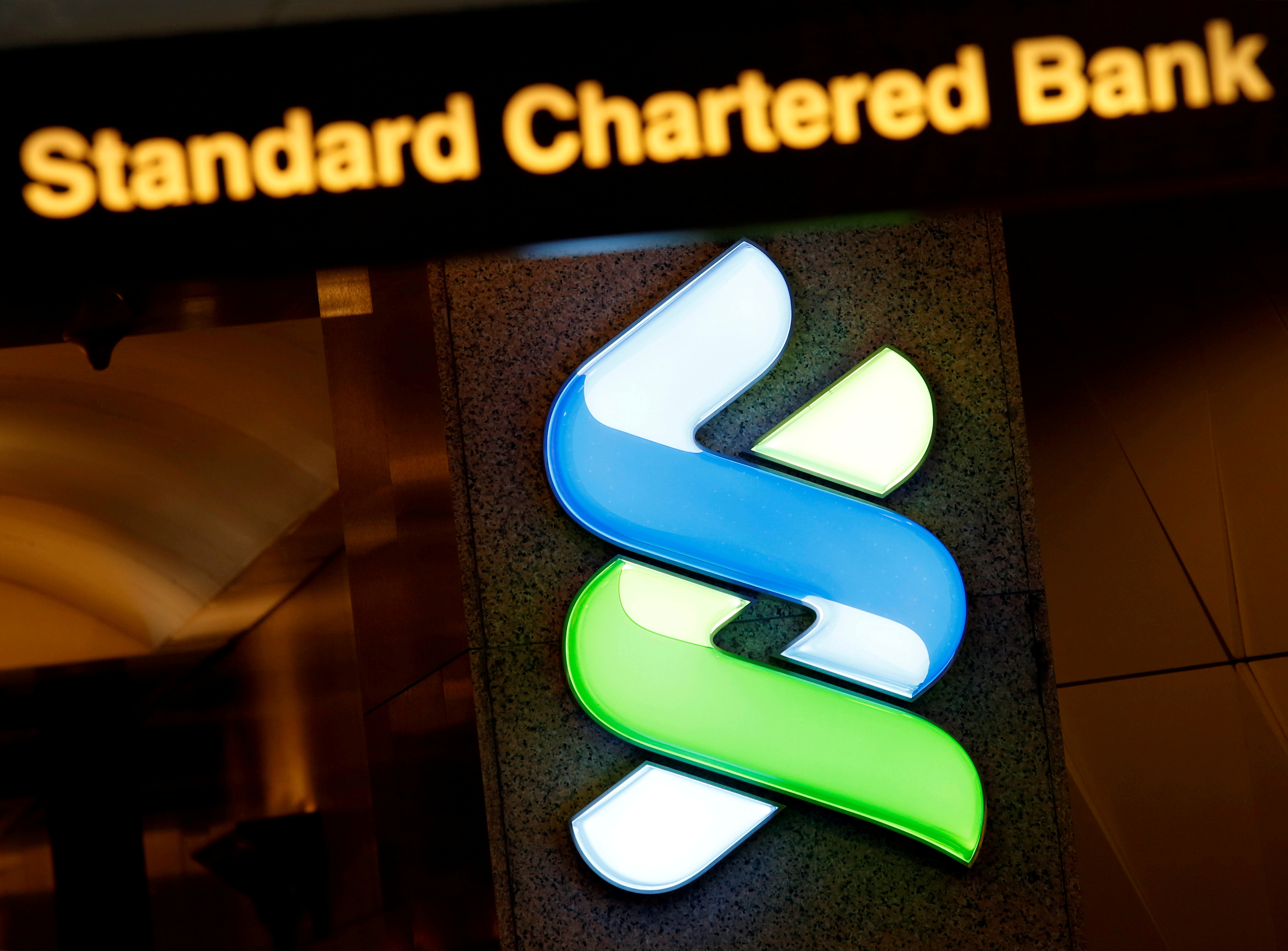A logo of Standard Chartered is displayed at its main branch in Hong Kong, China, Aug. 1, 2017. REUTERS/Bobby Yip/File Photo