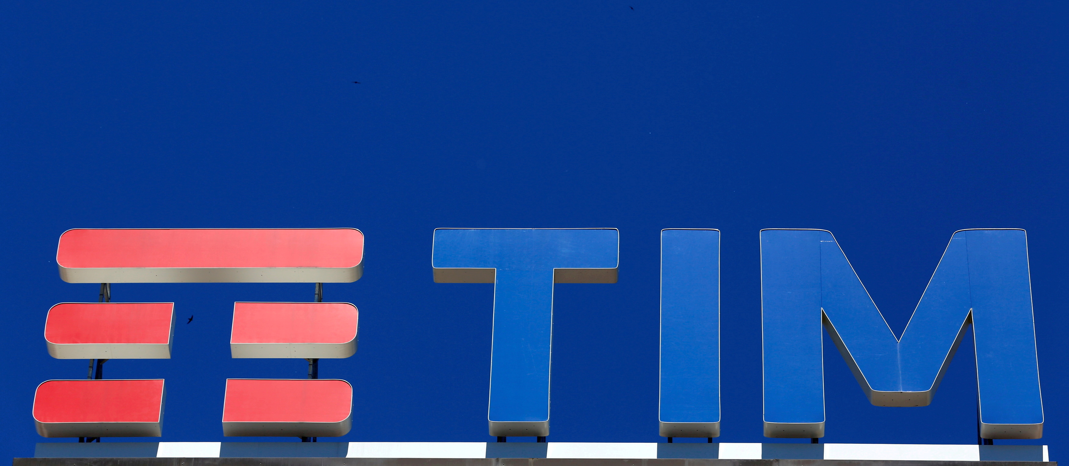 Telecom Italia's logo for the TIM brand is seen on building roof downtown Milan, Italy, May 20, 2016. REUTERS/Stefano Rellandini/File Photo