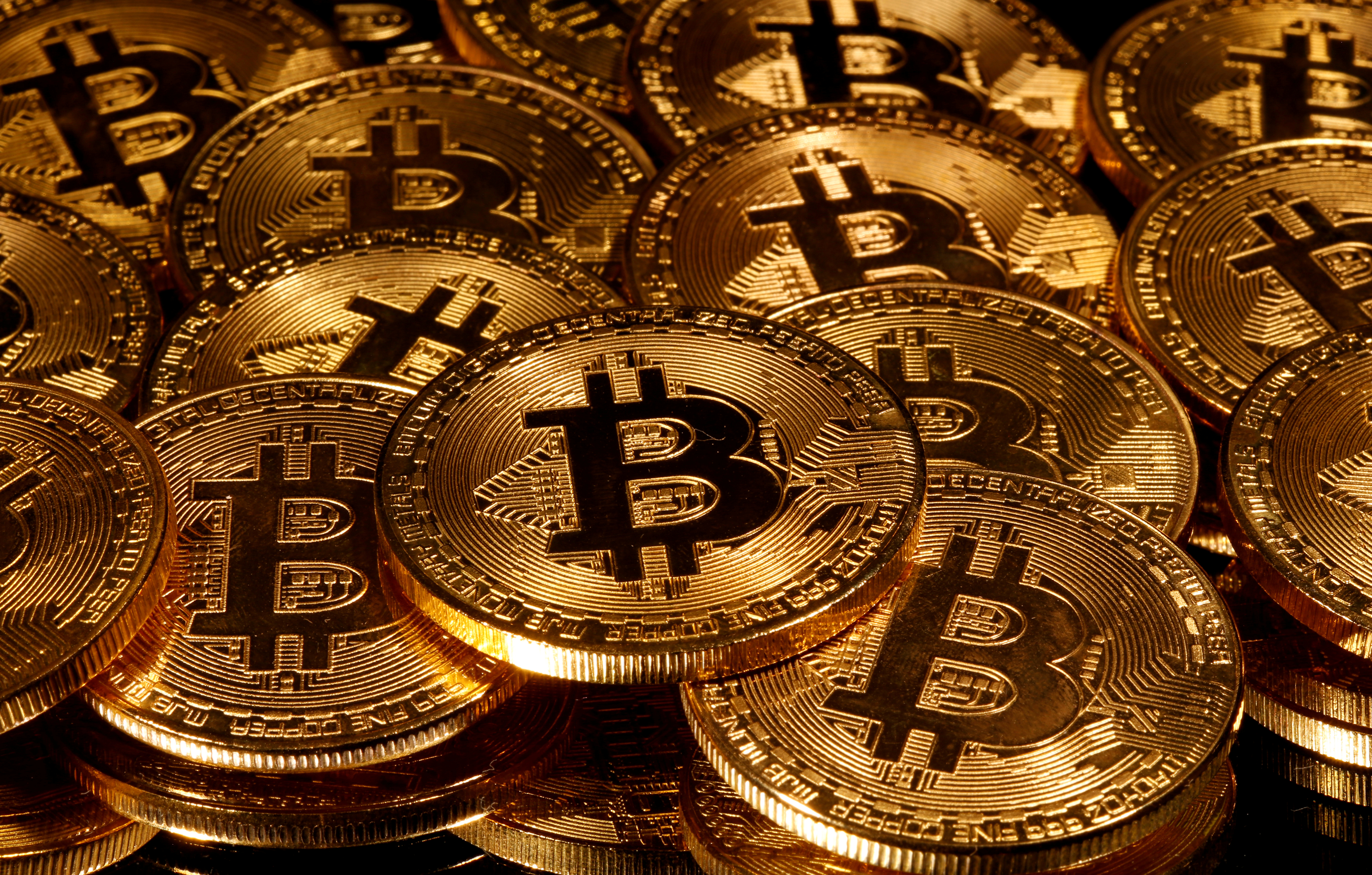 Representations of virtual currency Bitcoin are seen in this picture illustration taken taken March 13, 2020. REUTERS/Dado Ruvic/Illustration//File Photo