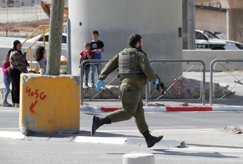 A member of the Israeli forces responds to a security incident near Ramallah, in the Israeli-occupied West Bank, June 12, 2021. REUTERS/Ammar Awad