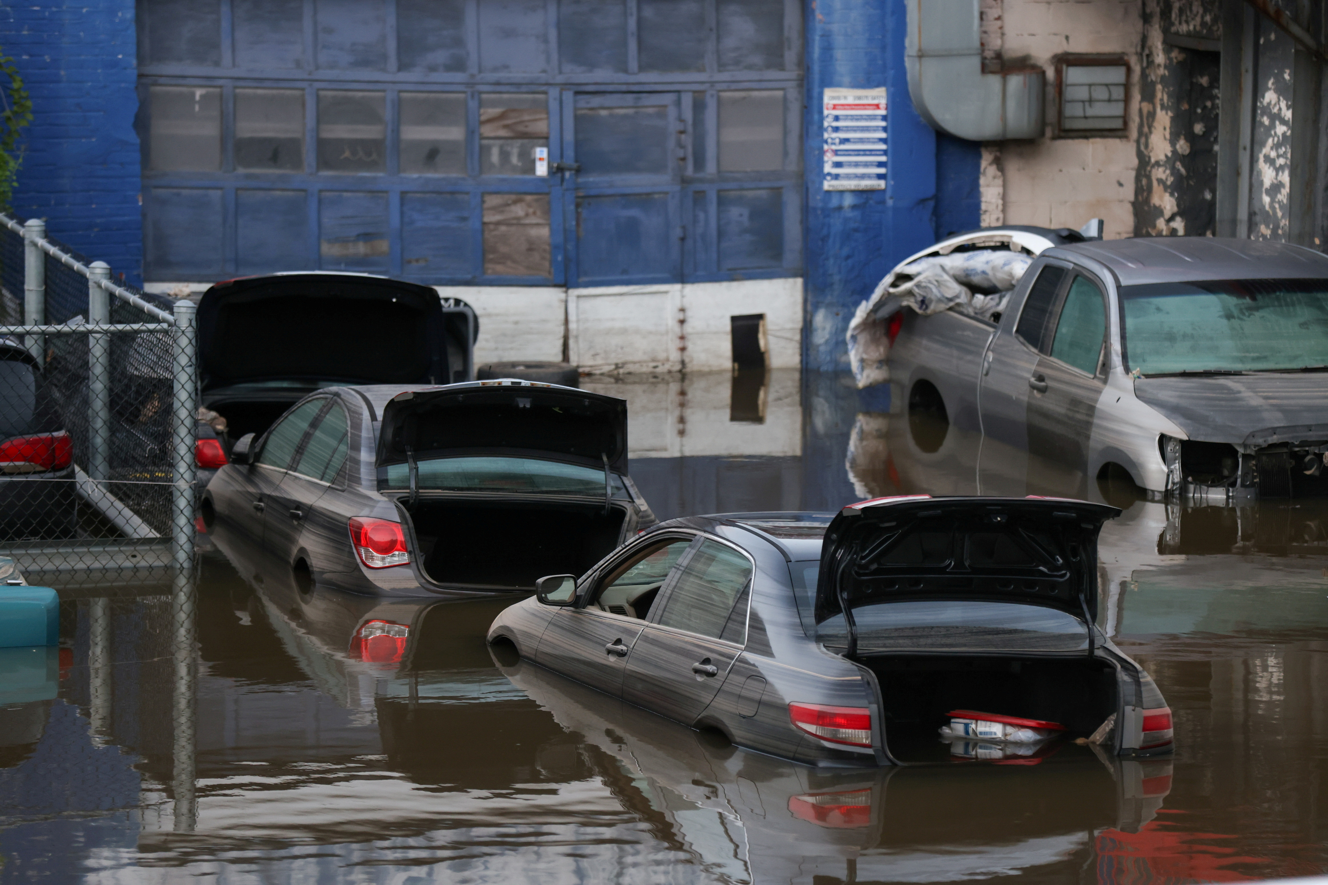Cars sit in water after flooding on the Major Deegan Expressway spilled over into the neighboring street and flooded a parking lot, when the remnants of Tropical Storm Ida brought drenching rain and the threat of flash floods and tornadoes to parts of the northern mid-Atlantic, in the Bronx borough of New York City, U.S., September 2, 2021. REUTERS/Caitlin Ochs/File Photo