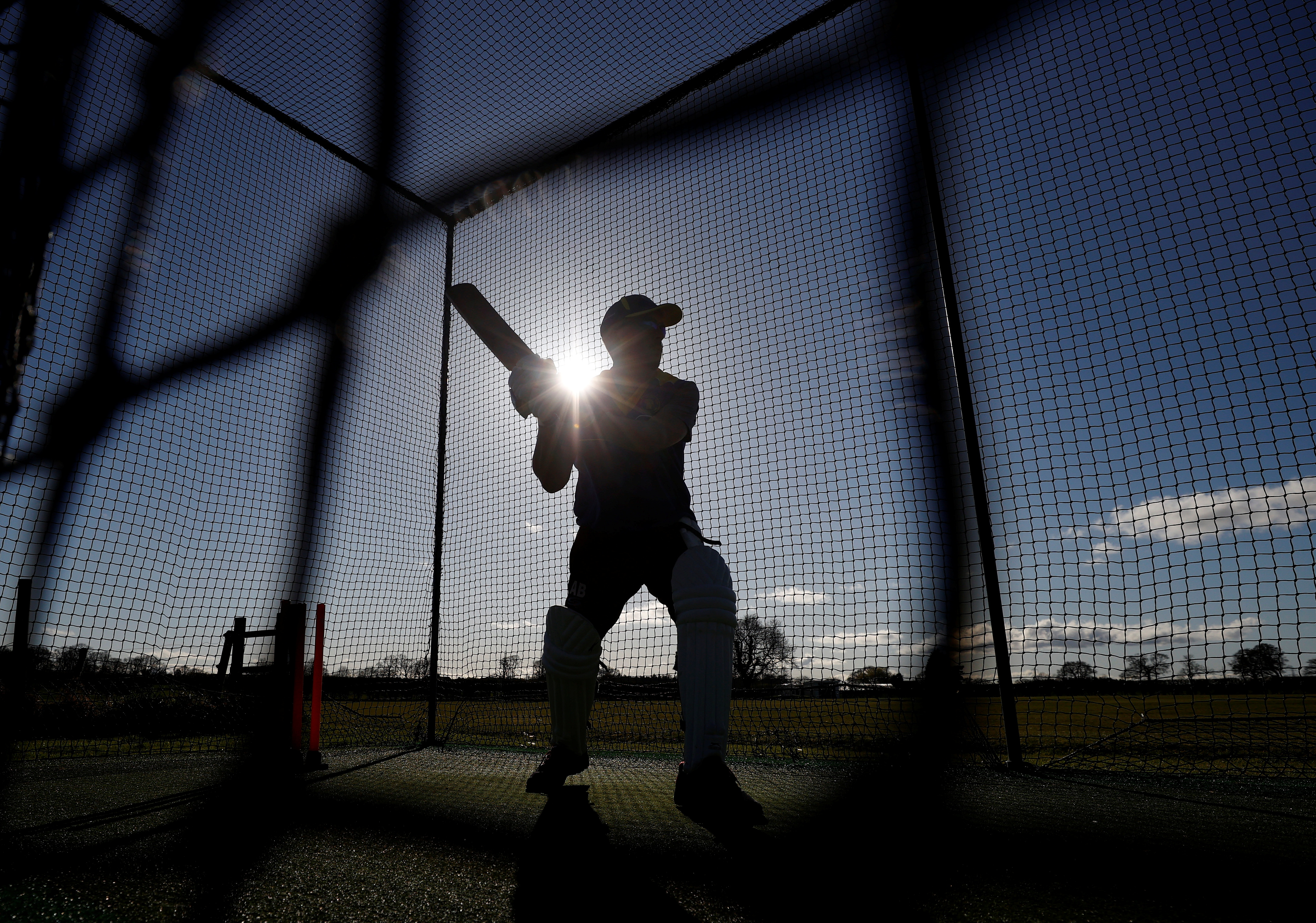 A player from Ashley Cricket Club practices his batting during a training session following the easing of lockdown restrictions, amid the outbreak of the coronavirus disease (COVID-19) in Ashley, Britain, March 29, 2021. REUTERS/Phil Noble