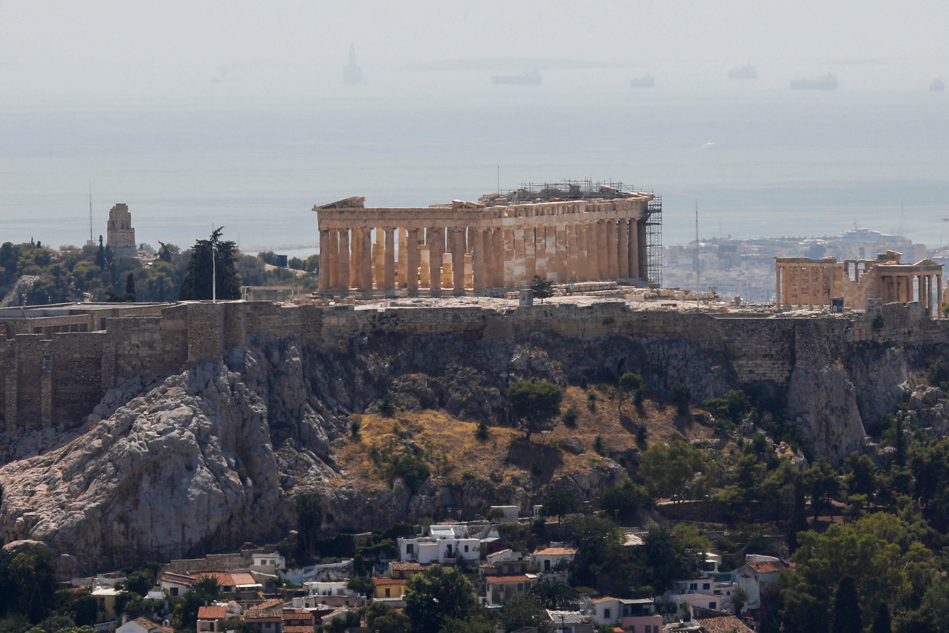 The Parthenon temple is seen atop the empty Acropolis hill archaeological site, closed to the public during a heatwave in Athens, Greece, July 30, 2021. REUTERS/Costas Baltas