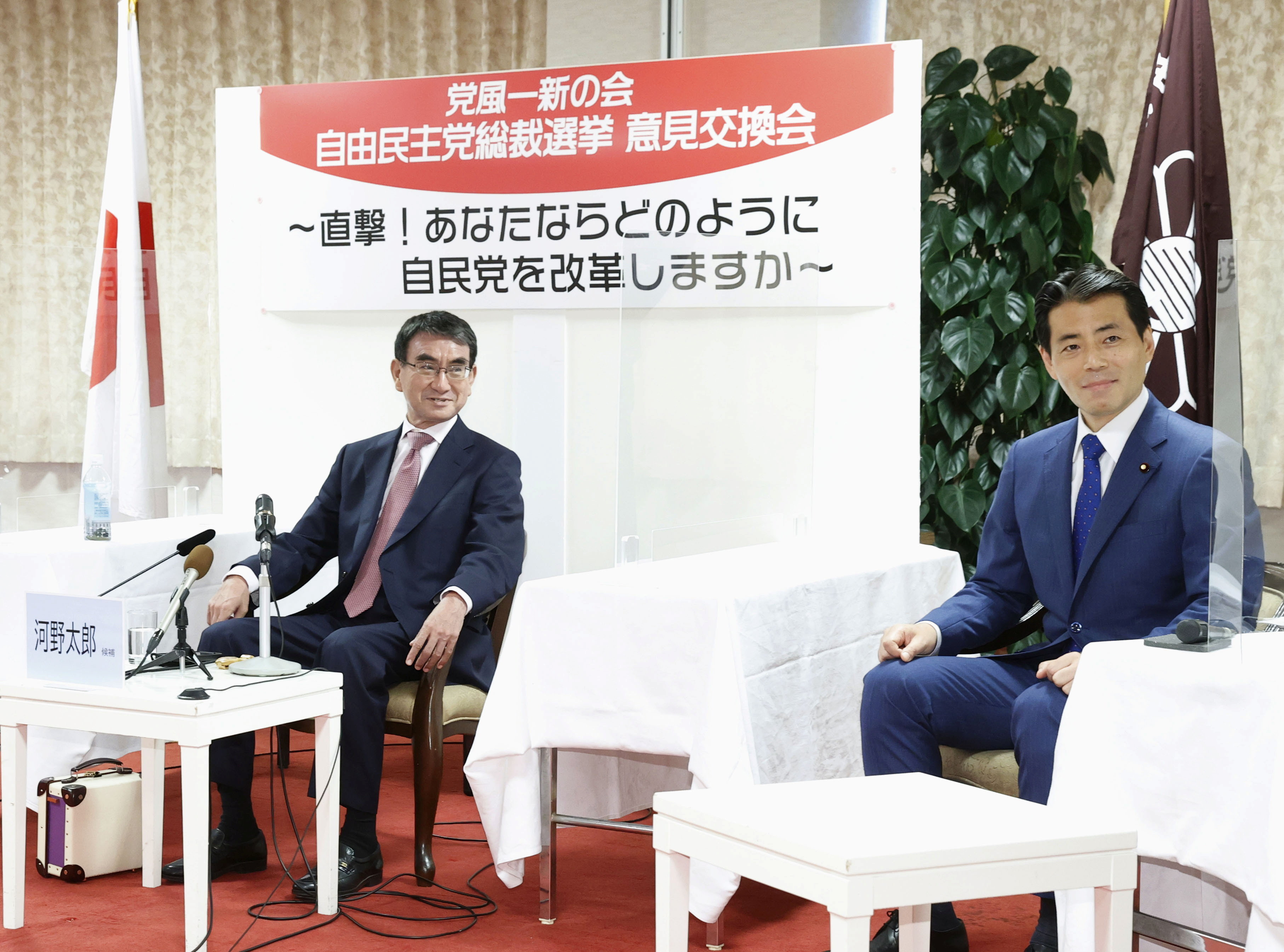 A candidate for the presidential election of the ruling Liberal Democratic Party (LDP), Taro Kono, the cabinet minister in charge of vaccinations, meets with LDP lawmaker Tatsuo Fukuda during their discussion meeting in Tokyo, Japan September 21, 2021, in this photo taken by Kyodo. Picture taken September 21, 2021. Mandatory credit Kyodo/via REUTERS