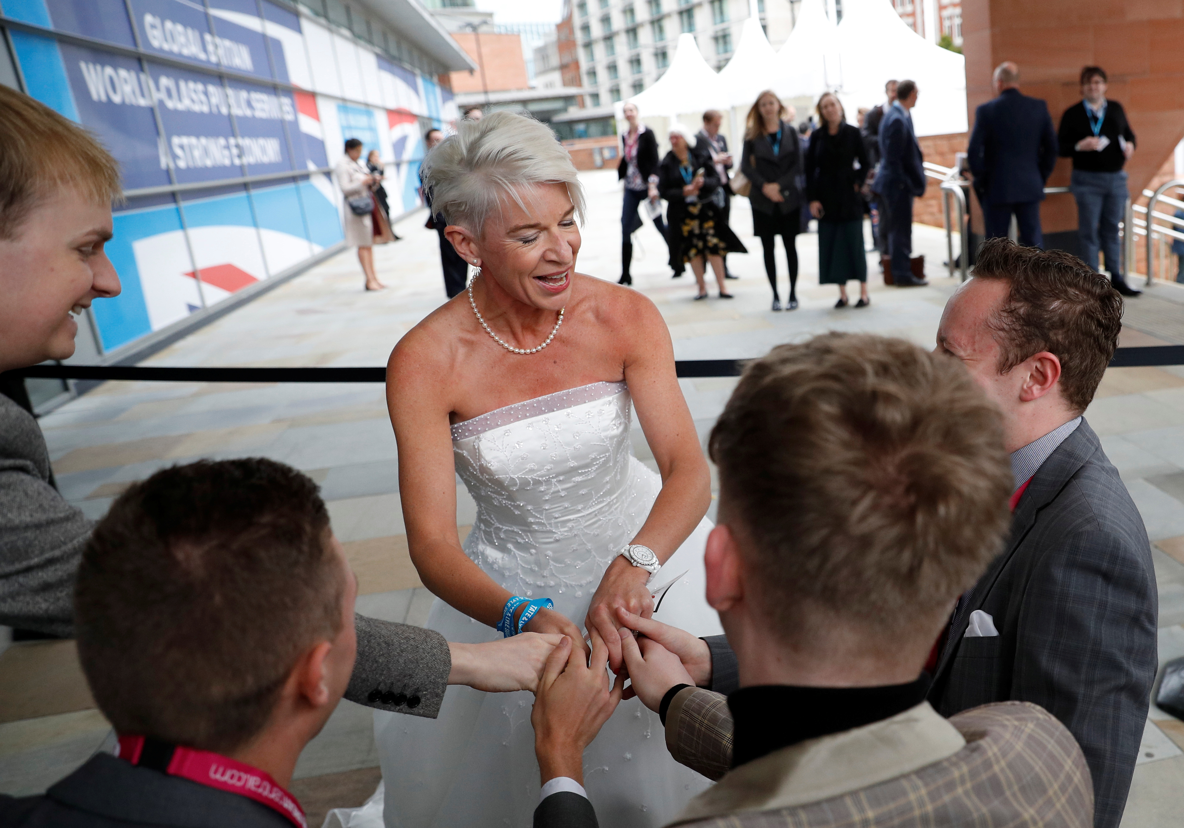 Newspaper columnist Katie Hopkins arrives dressed in a wedding dress at the Conservative Party's conference in Manchester, Britain October 2, 2017. REUTERS/Phil Noble