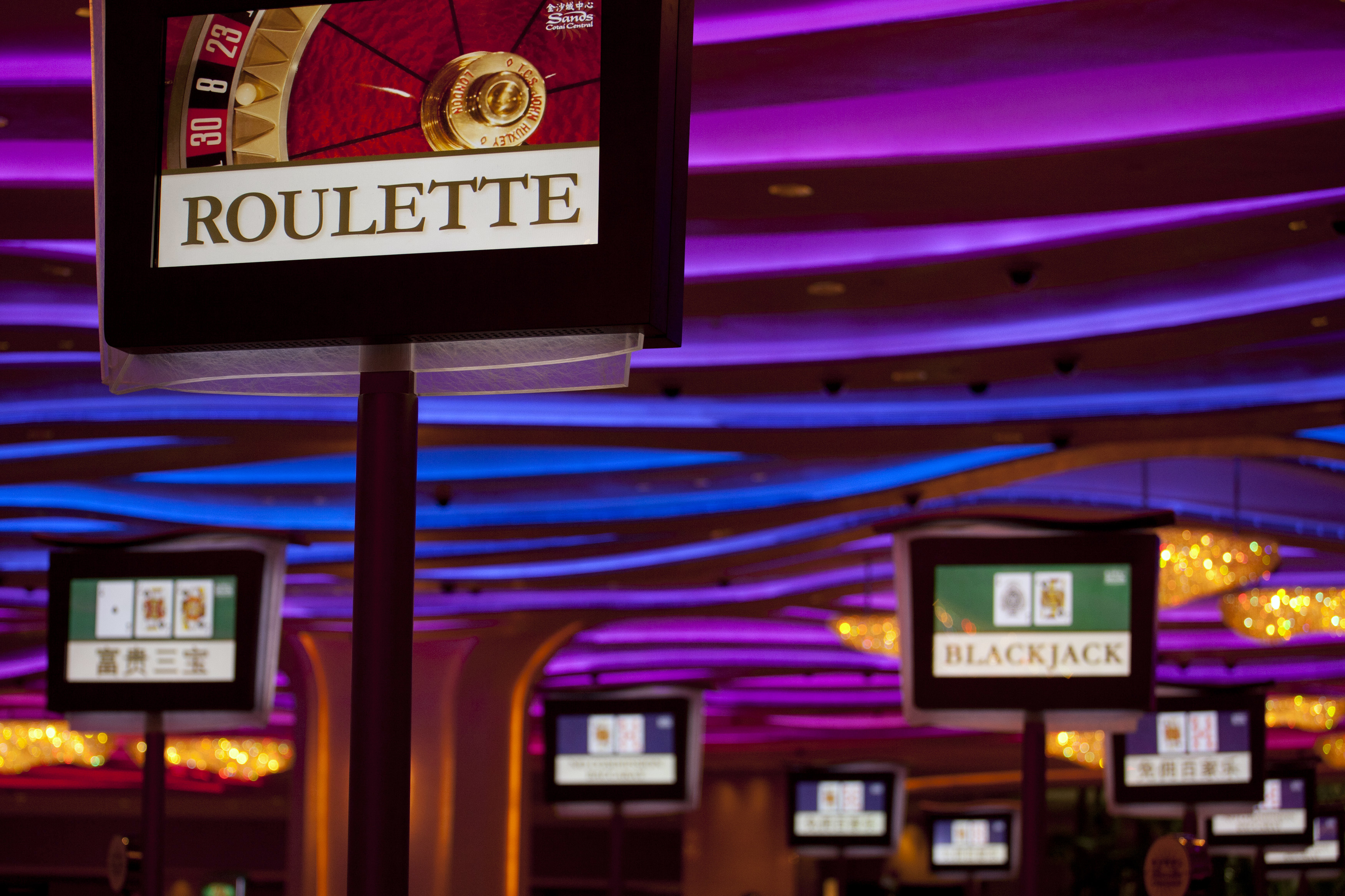 Electronic monitors are seen inside a casino on the opening day of Sheraton Macao hotel at Sands Cotai Central in Macau September 20, 2012.  REUTERS/Tyrone Siu