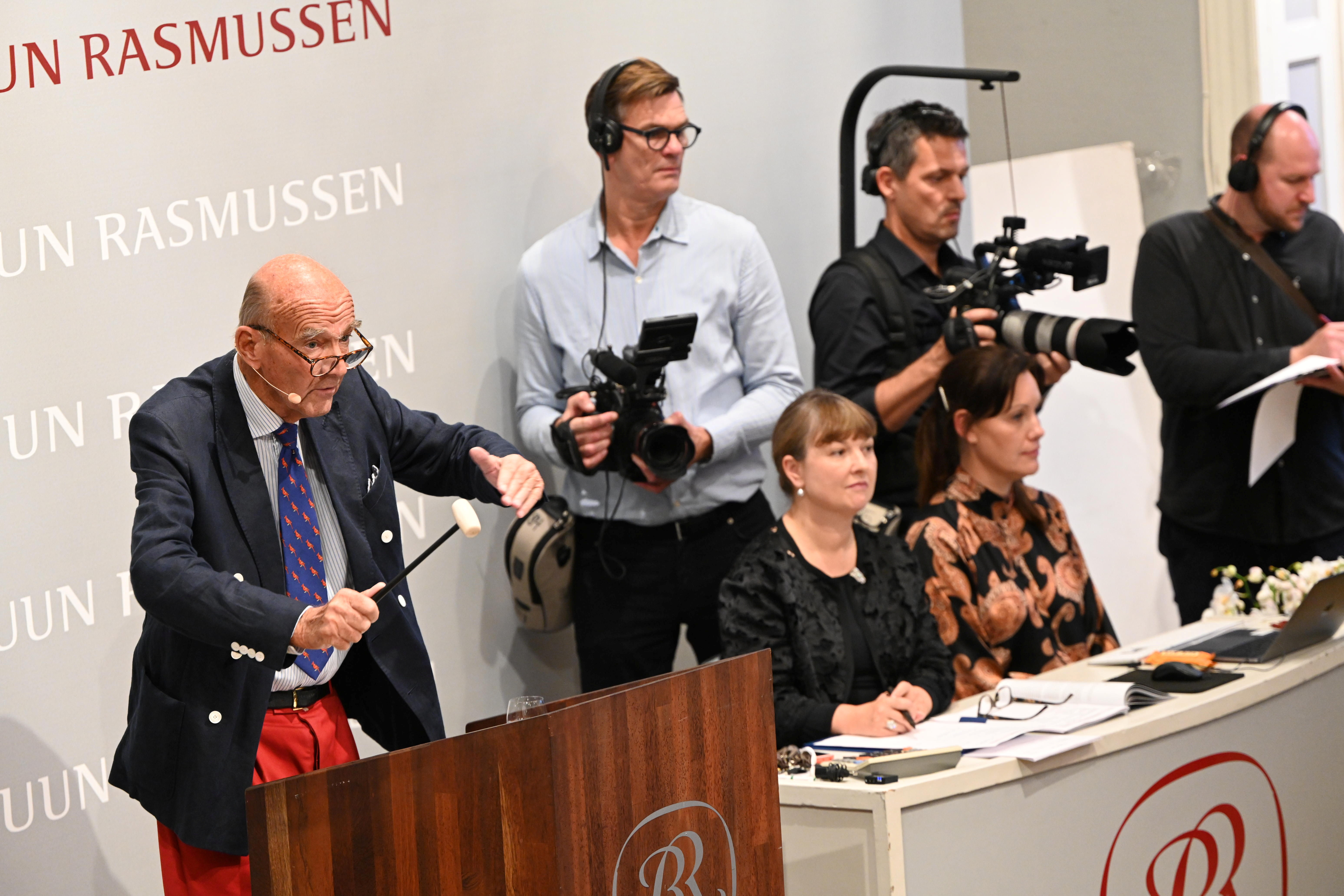 Staff auction a cassette with the recording of Danish schoolboys' interviews with John Lennon and Yoko Ono during the couple's winter stay in Thy, Jutland, Denmark in 1970 at Bruun Rasmussen Auction House in Copenhagen, Denmark, September 28, 2021. The auction includes the interviews and song