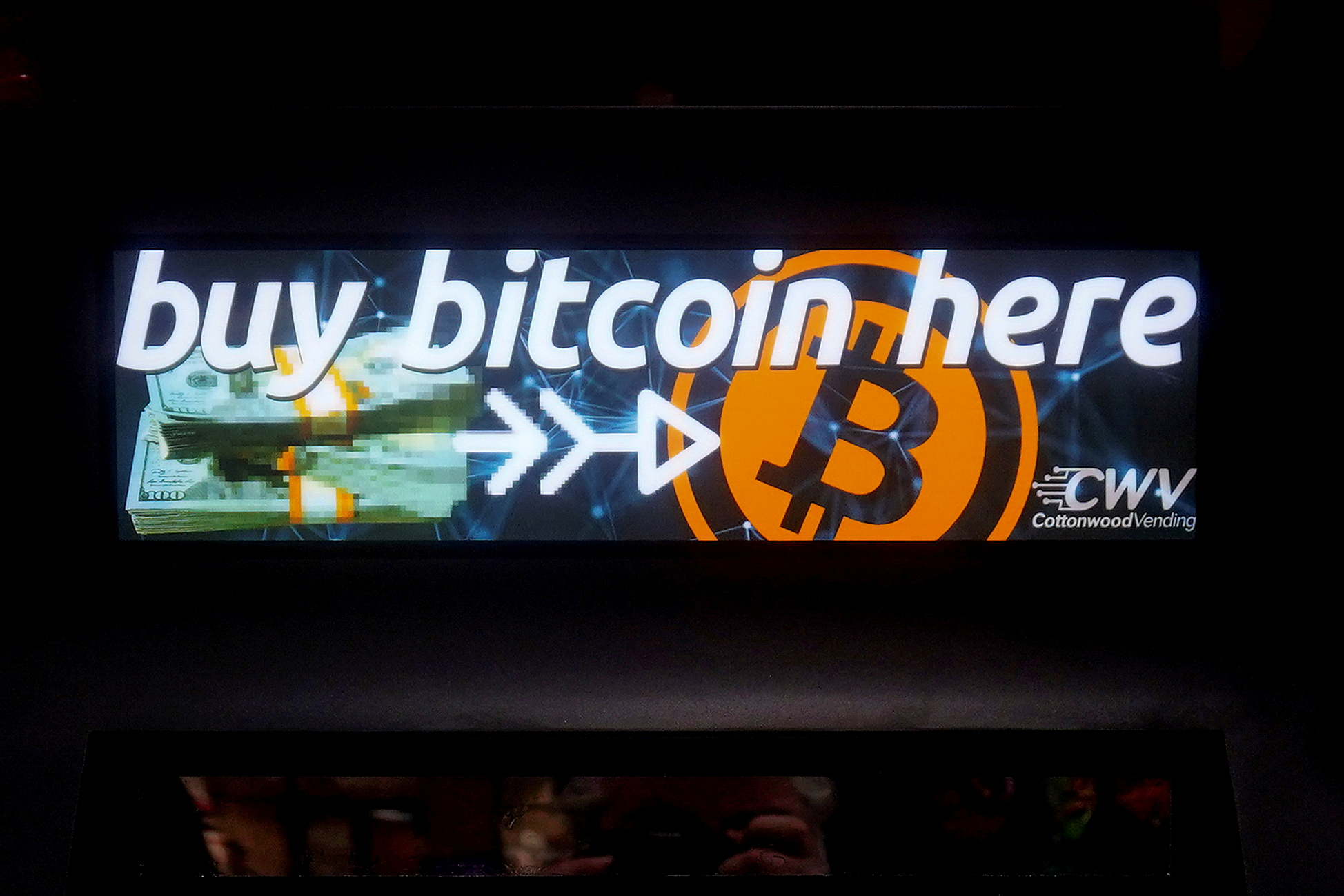 A Bitcoin ATM sign is pictured in a bodega in the Manhattan borough of New York City, New York, U.S., February  9, 2021. REUTERS/Carlo Allegri