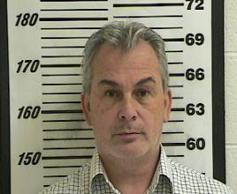Michael Taylor, who was implicated in enabling the dramatic escape of former Nissan Motor Co boss Carlos Ghosn, is seen in a booking photograph from October 24, 2012 on unrelated charges and released by the Davis County Sherriff's office. Davis County Sherriff's office/Handout via REUTERS
