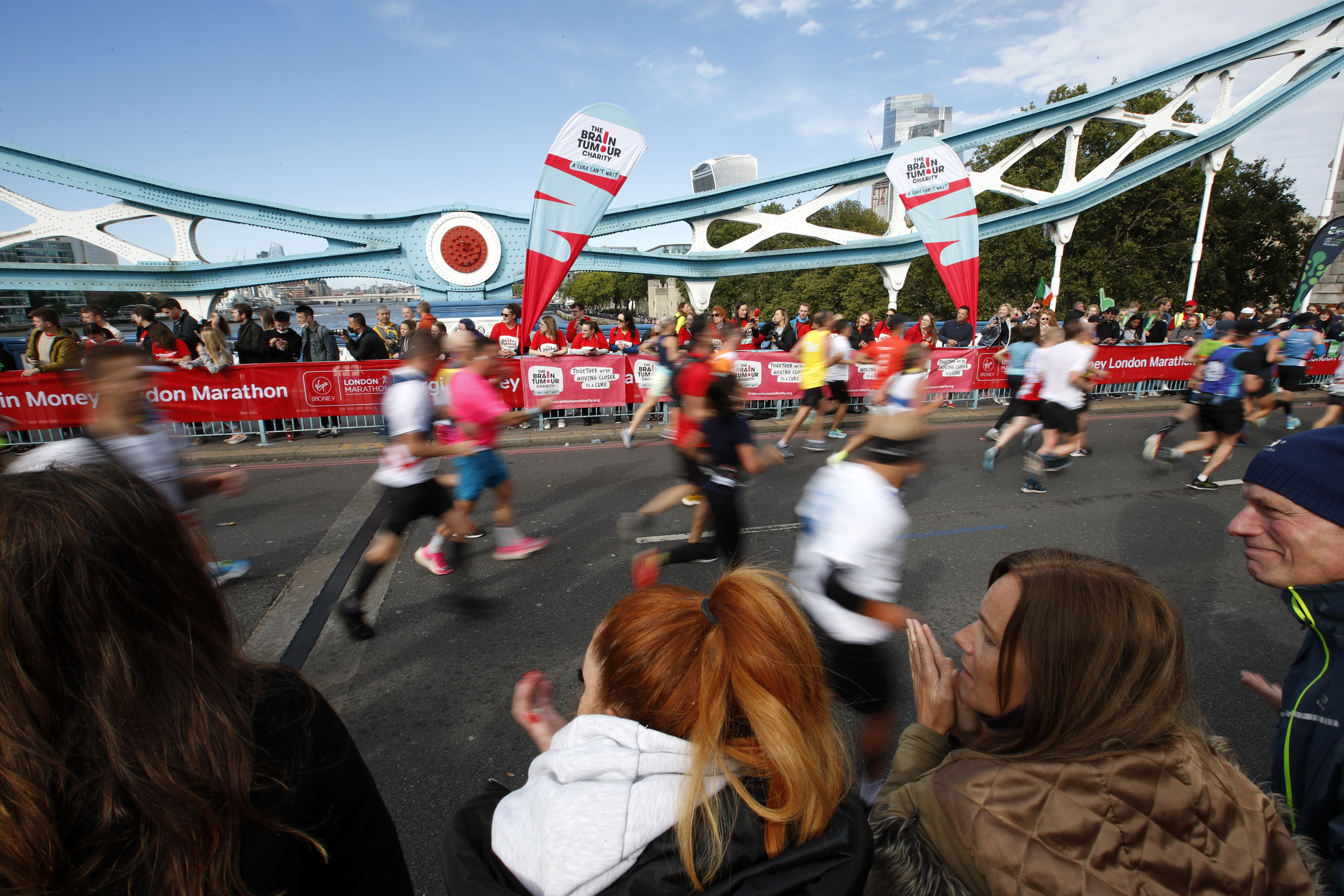 Athletics - London Marathon - London, Britain - October 3, 2021 Spectators watch runners during the London Marathon as they run over Tower Bridge Action Images via Reuters/Andrew Boyers