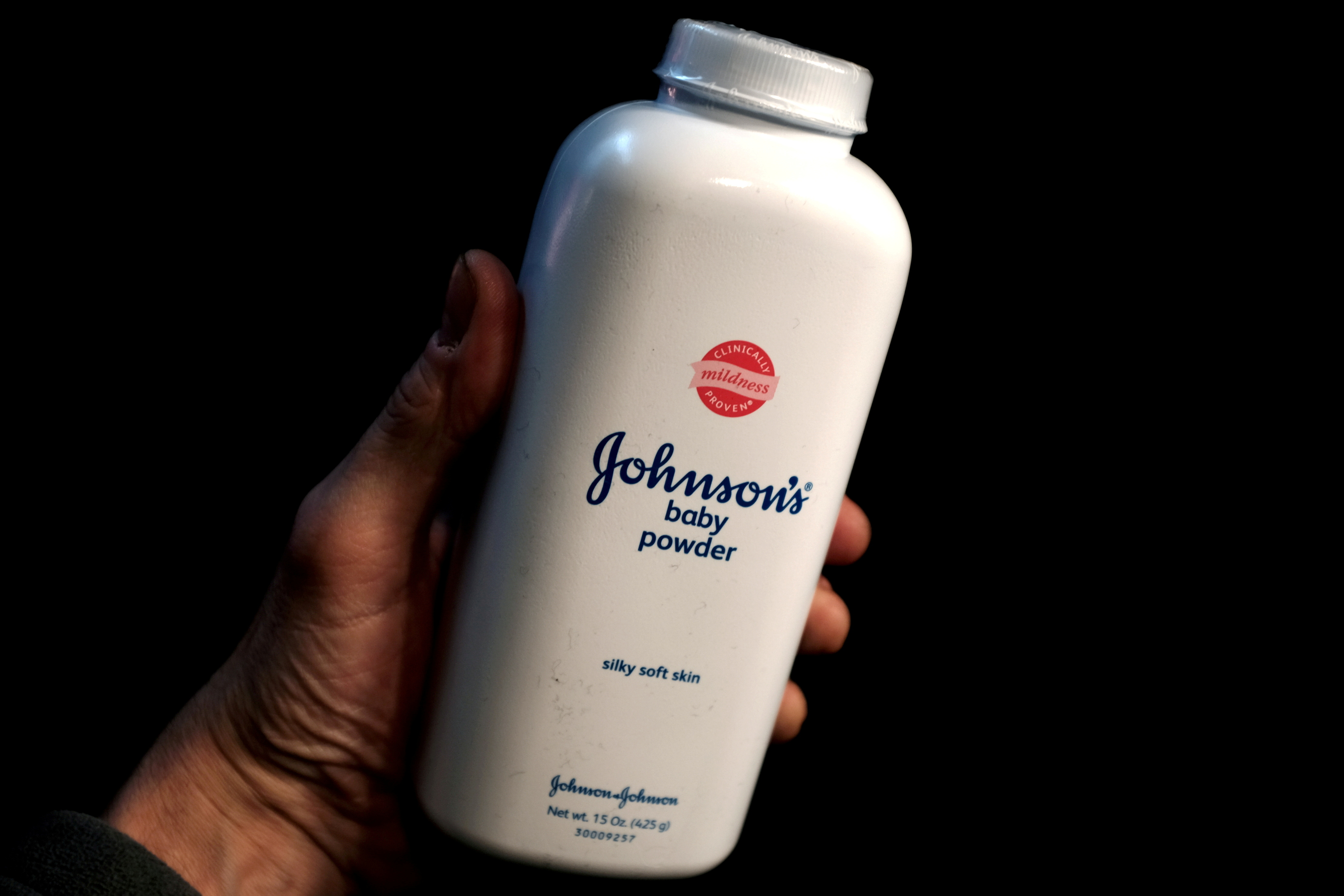 A bottle of Johnson and Johnson Baby Powder is seen in a photo illustration taken in New York. REUTERS/Mike Segar