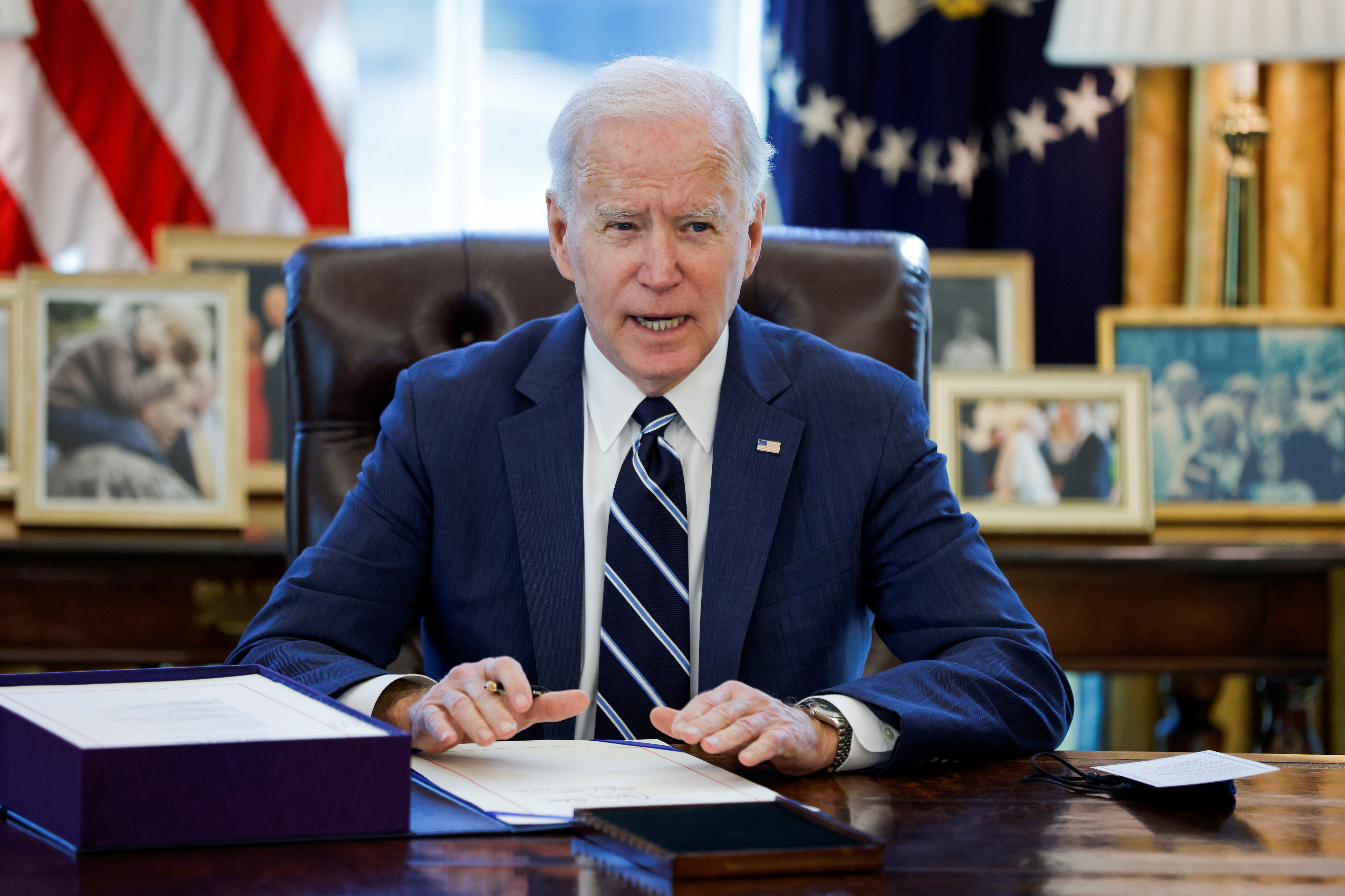 U.S. President Joe Biden signs the American Rescue Plan, a package of economic relief measures to respond to the impact of the coronavirus disease (COVID-19) pandemic, inside the Oval Office at the White House in Washington, U.S., March 11, 2021. REUTERS/Tom Brenner