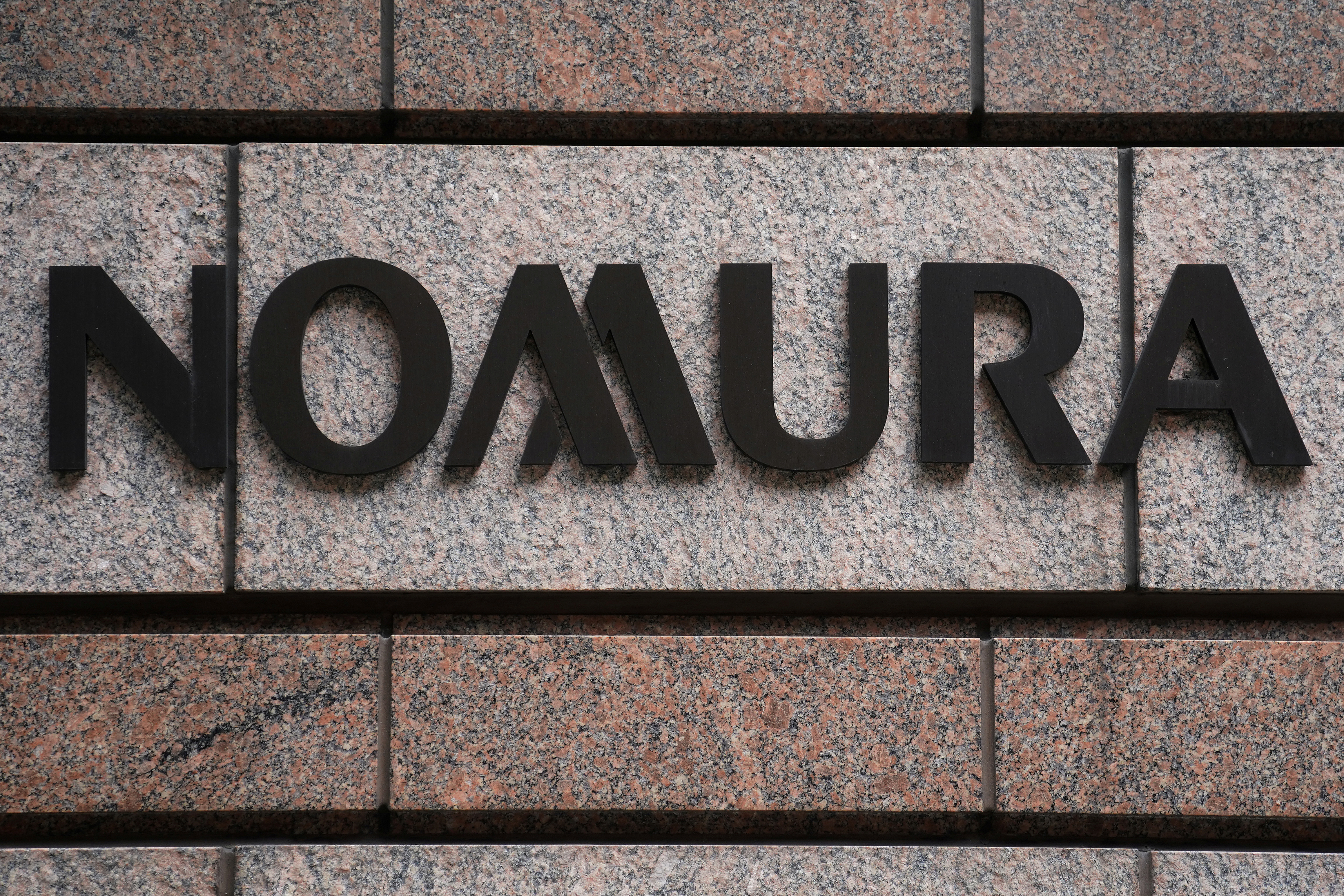 A Nomura logo is pictured at the Japanese company's office in the Manhattan borough of New York City, New York, U.S. June 23, 2017.   REUTERS/Carlo Allegri