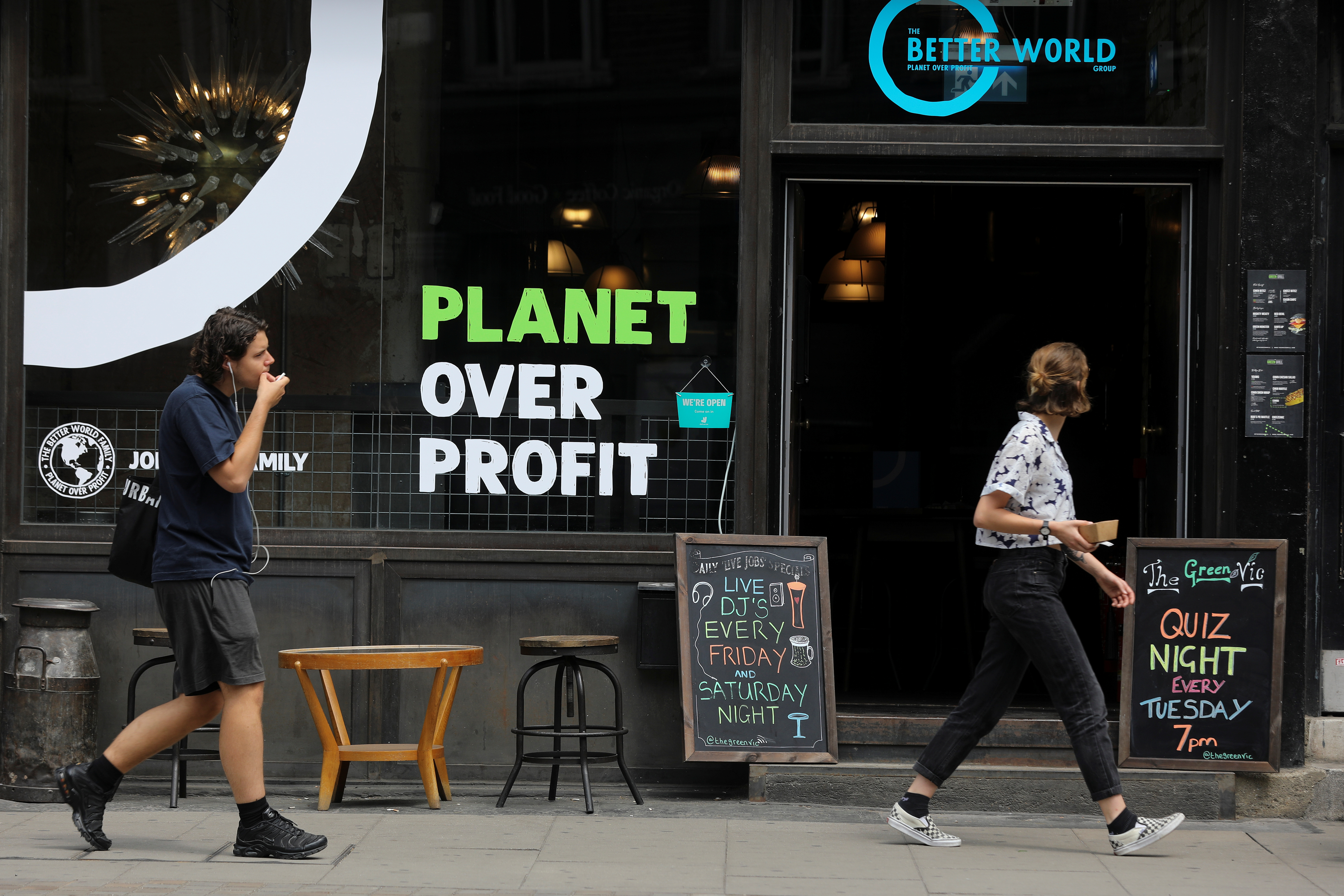 Pedestrians walk past the Green Vic, which is aiming to be the world's most ethical pub, in Shoreditch, London, Britain July 5, 2019. REUTERS/Simon Dawson